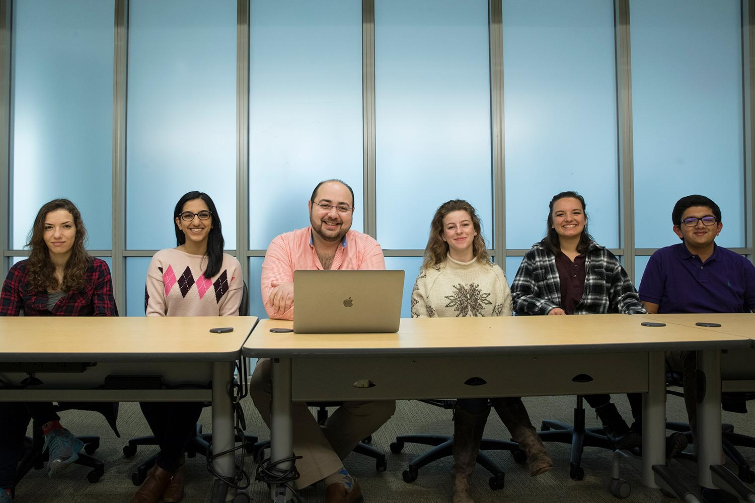 Computer science professor Ahmed Ibrahim, center, with students, from left, Monique Mezher, Simmy Bhatia, Maggie Gates, Mariah Kenny and Shaishav Naik.
