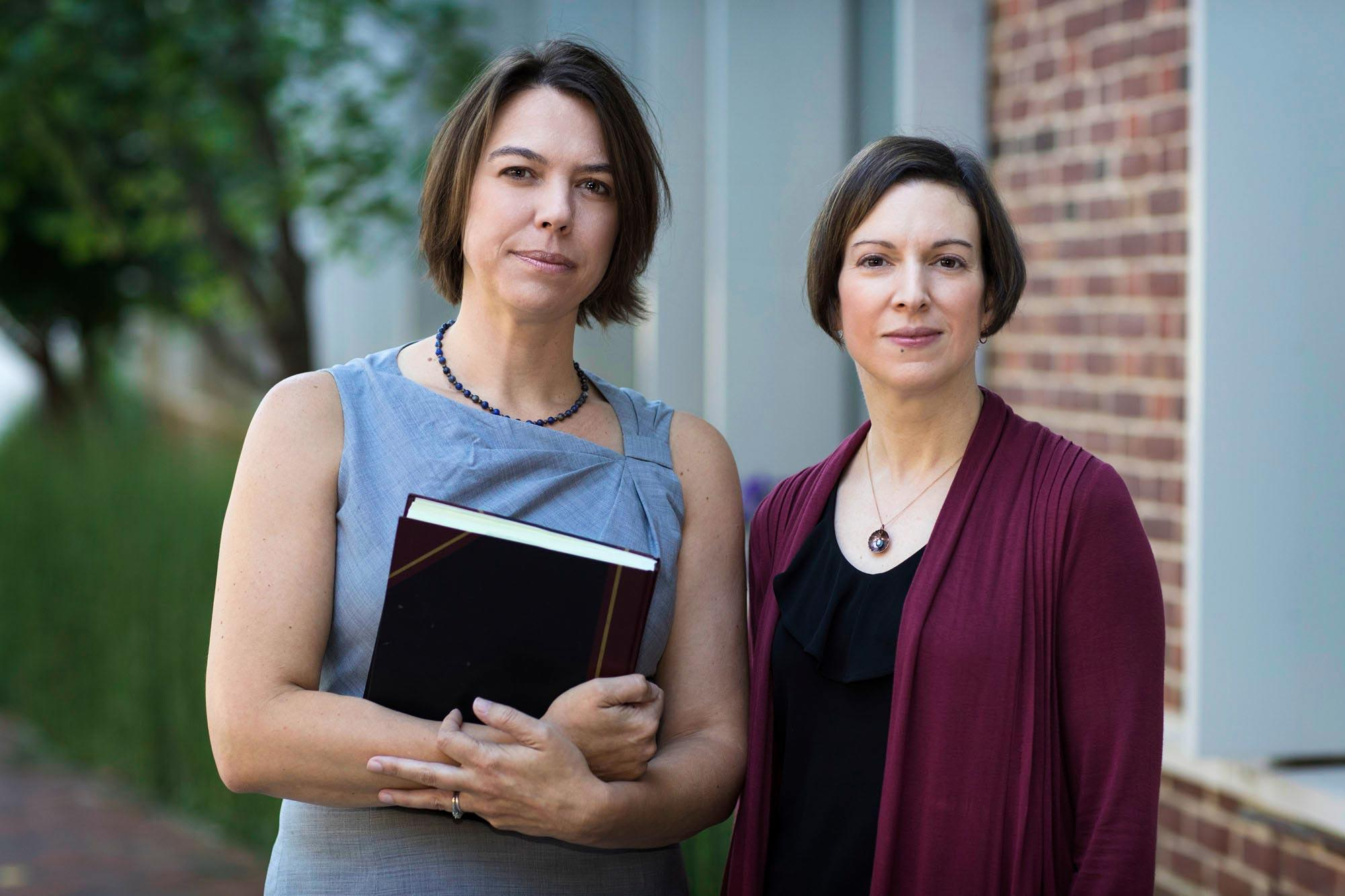 Chemist Linda Columbus, co-director of the Global Infectious Diseases Institute, left, and Microbiologist Alison Criss, director.