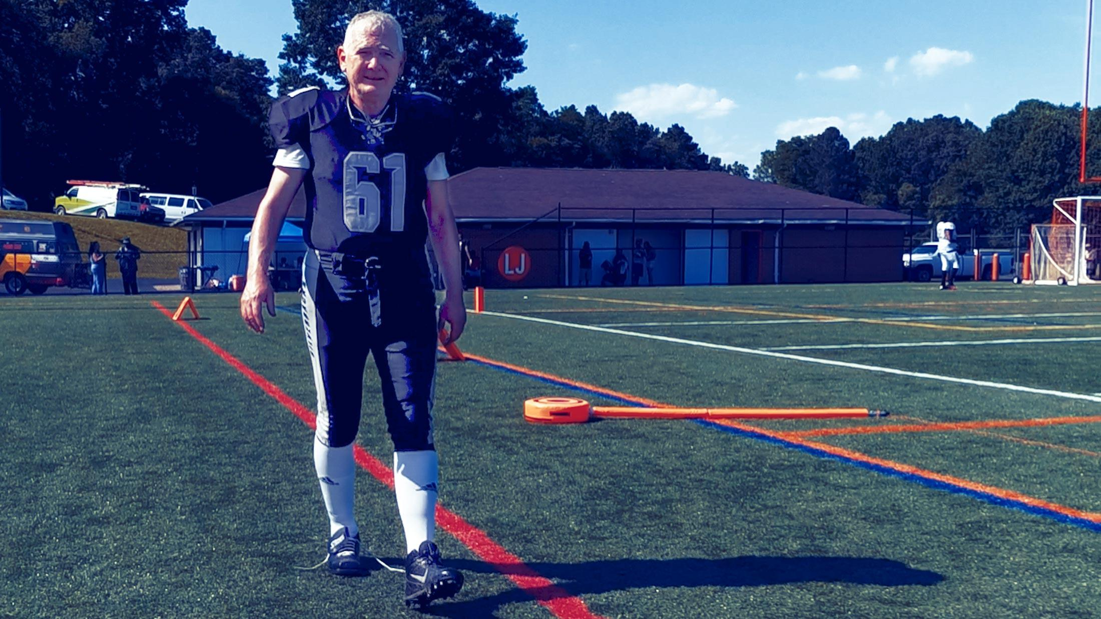 Professor Allen Lynch playing football