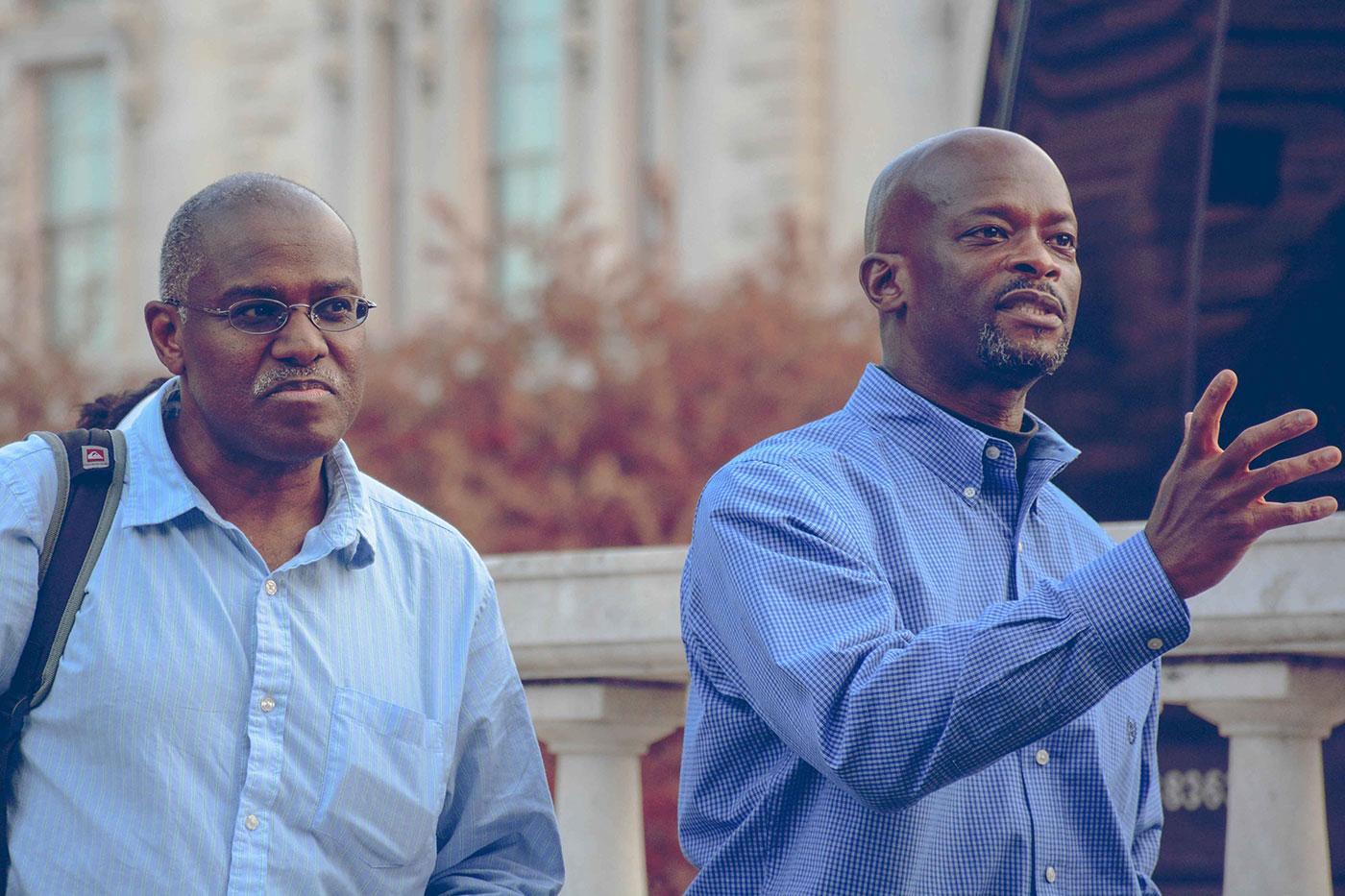 English Professor Marlon B. Ross, left, and University Professor K. Ian Grandison, a landscape architect by training, begin a walking tour of Baltimore with 14 UVA students.