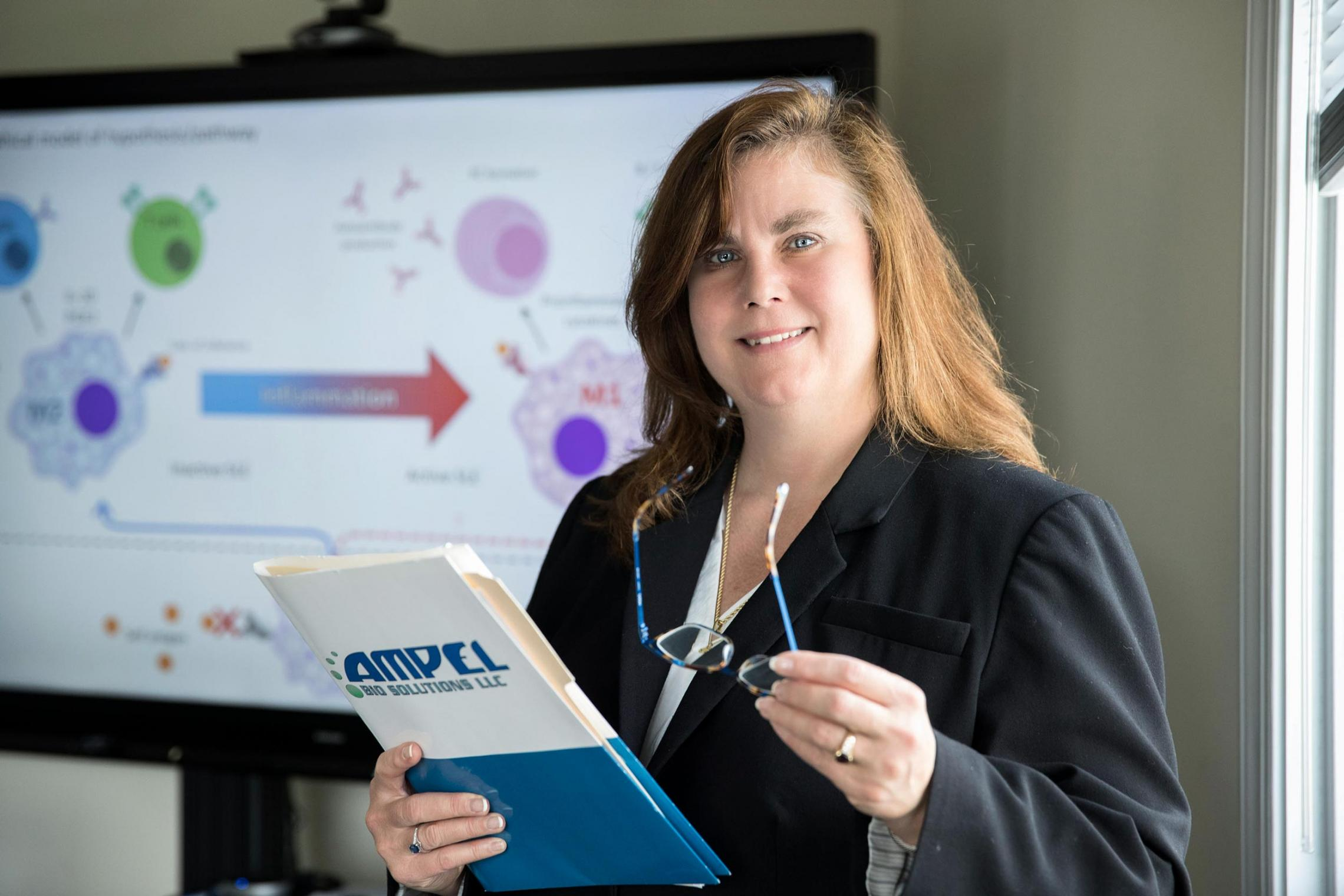 Amrie Grammer, founder, chief operating officer and chief science officer at Charlottesville-based biotech company AMPEL Biosolutions, maintains close ties to the University.