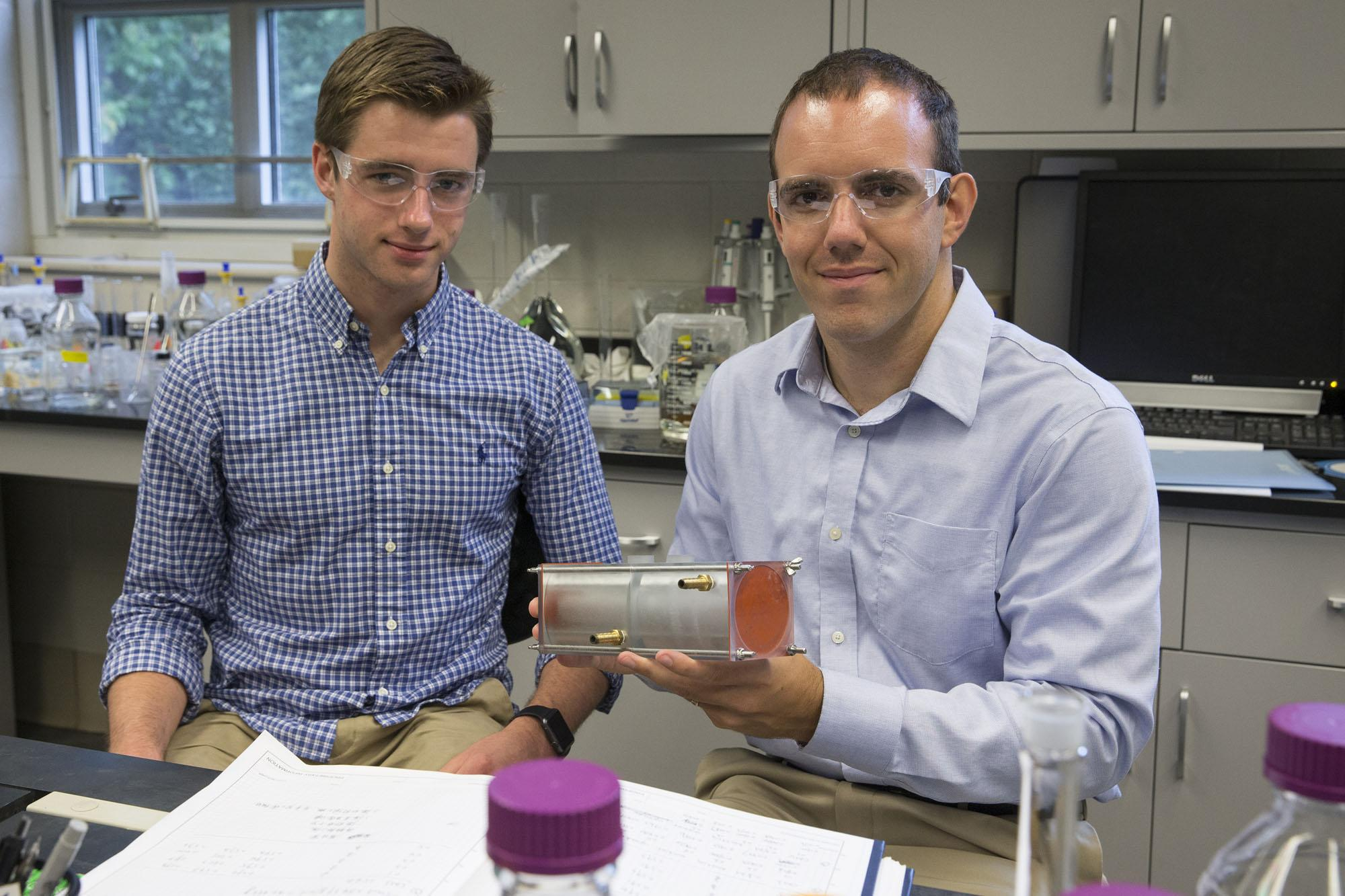 Chemical engineering major Andrew Biedermann (left), works on polymer membranes with Geoffrey Geise, an assistant professor in the Department of Chemical Engineering. Photo by Dan Addison / University Communications.