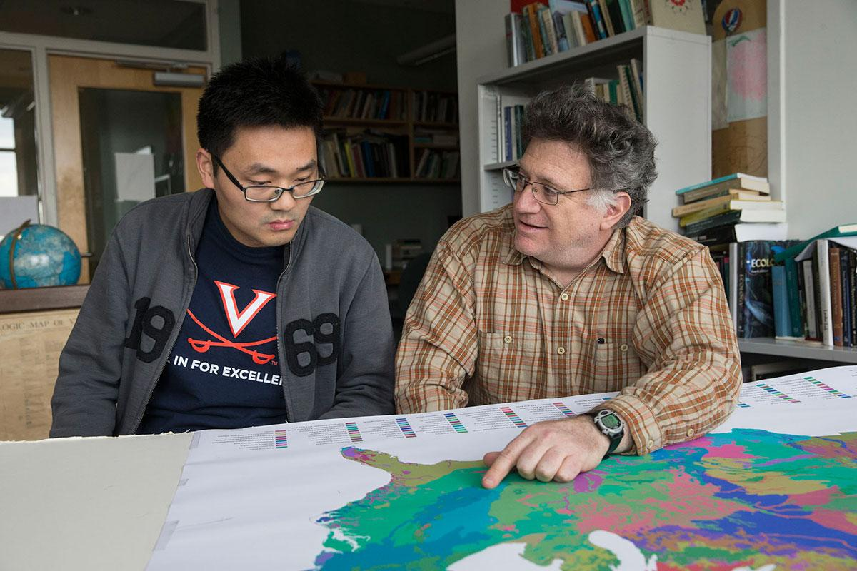 Environmental scientist Manuel Lerdau, right, and Ph.D. candidate Bin Wang took a closer look at the effects of surface ozone on forests.