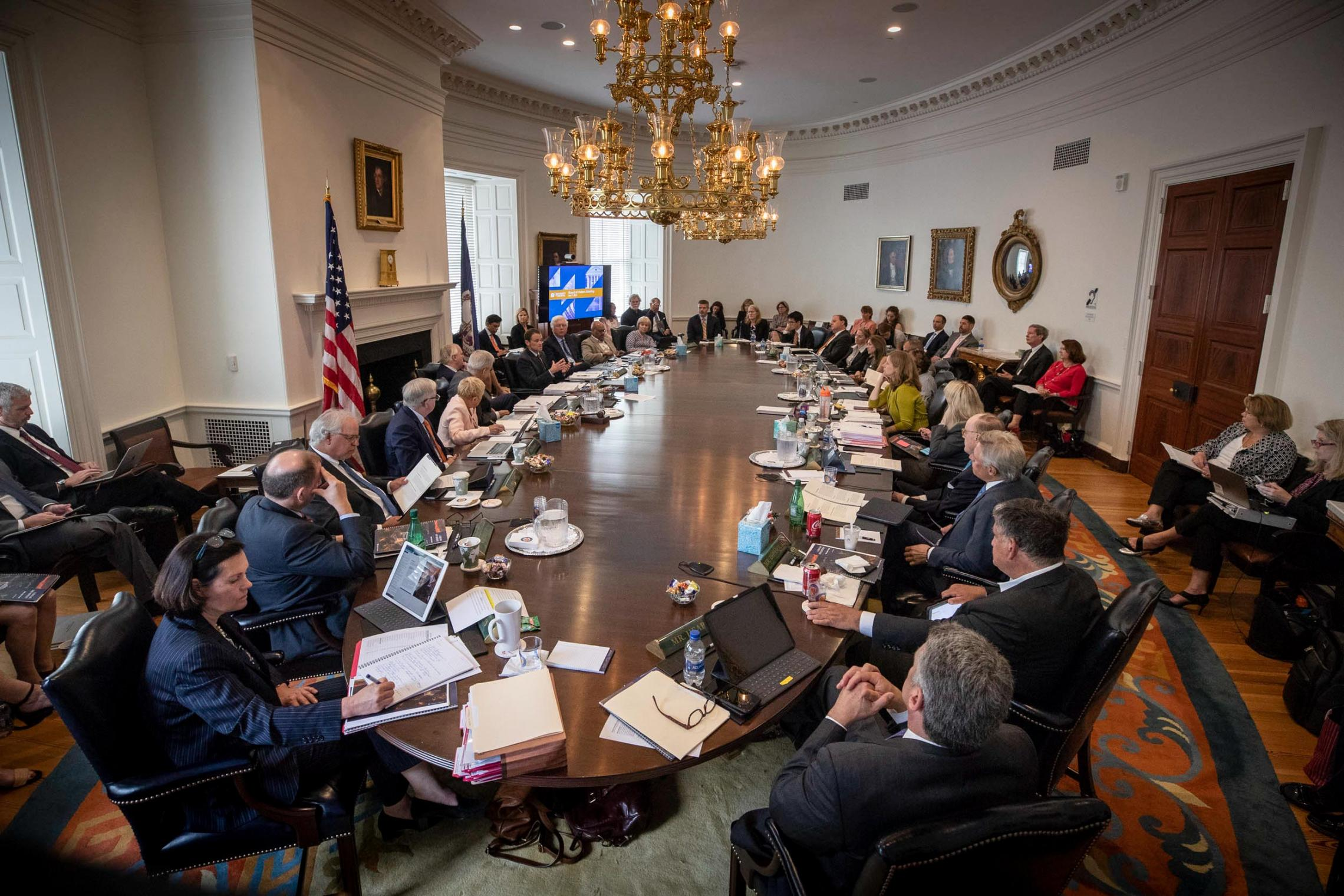 UVA President Jim Ryan (center, seated just to left of screen) presents the strategic plan to the Board of Visitors on Friday.