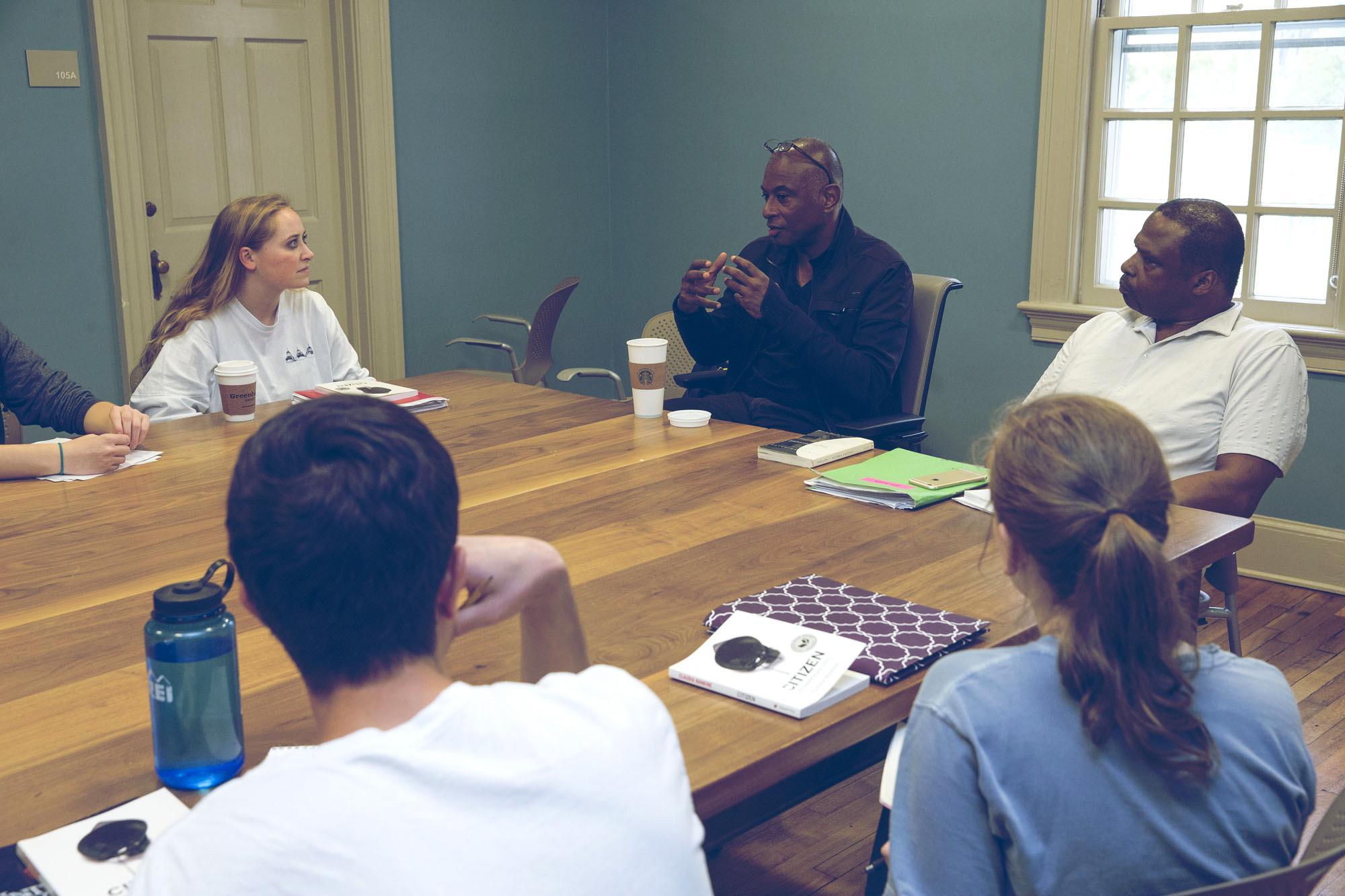 Caryl Phillips, UVA Kapnick Foundation Distinguished Writer-in-Residence, visited a graduate fiction-writing workshop last week taught by UVA professor Jeffery Allen. (Photo by Dan Addison/University Communications)
