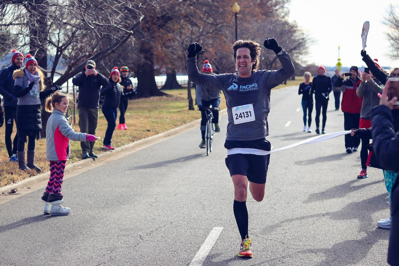 Chris Farley crosses the finish line of a marathon last December that family, friends and employees organized just for him.