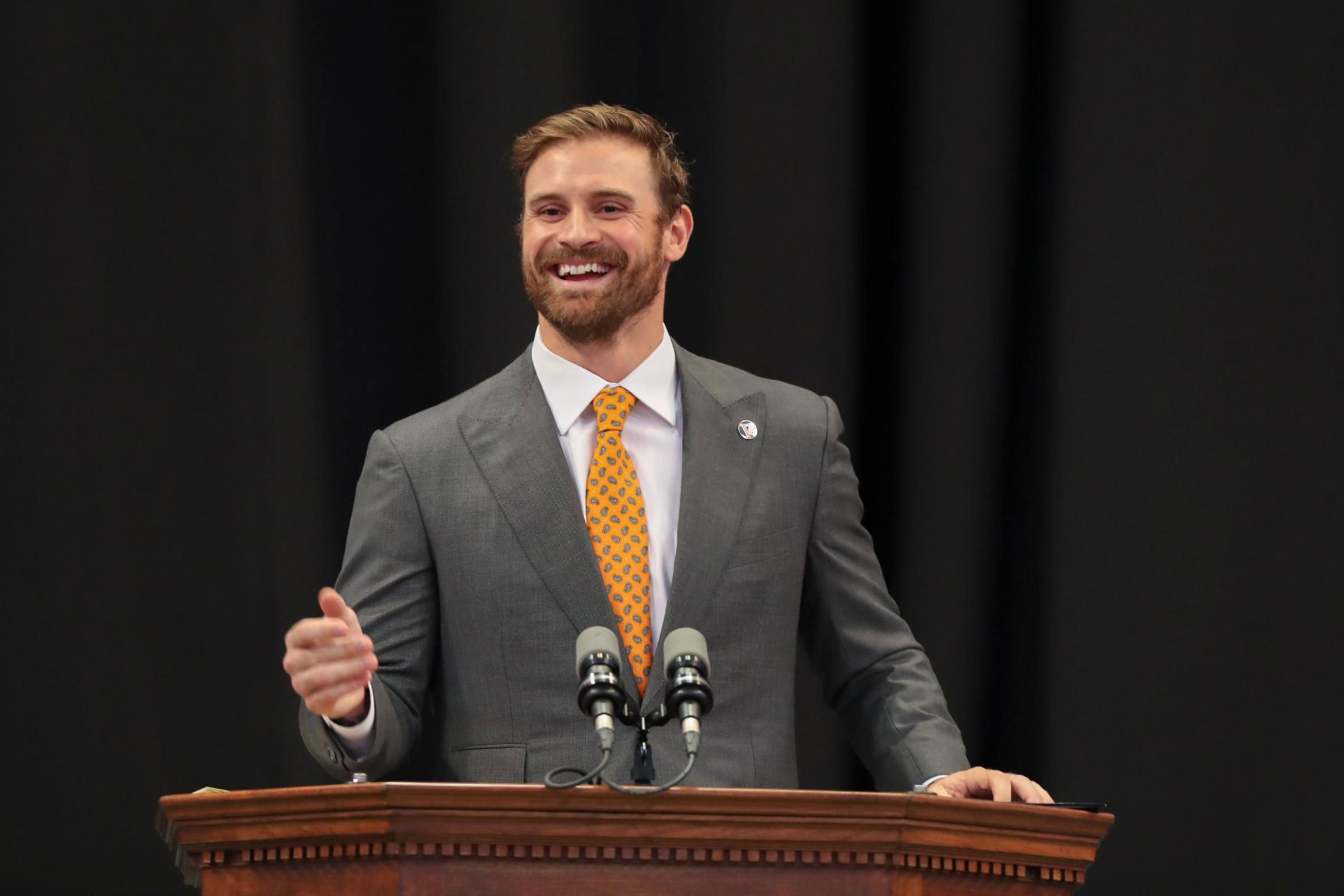 Retired NFL player Chris Long, pictured here delivering UVA's valedictory keynote in 2018, has extended his philanthropic efforts all over the world. (Photo by Dan Addison, University Communications)