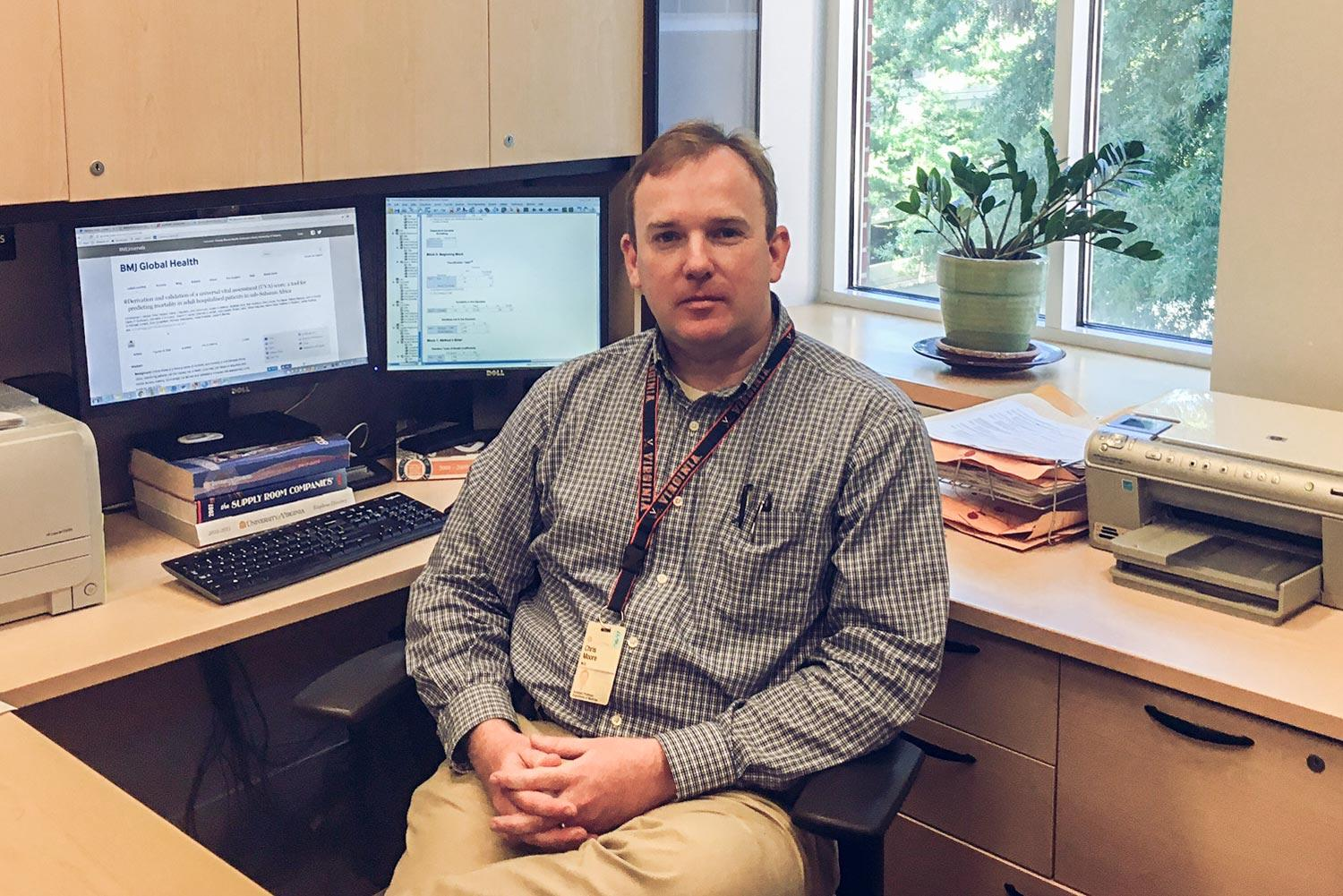 Dr. Christopher Moore developed the new triage tool as part of an international team that included representatives of three schools at UVA.