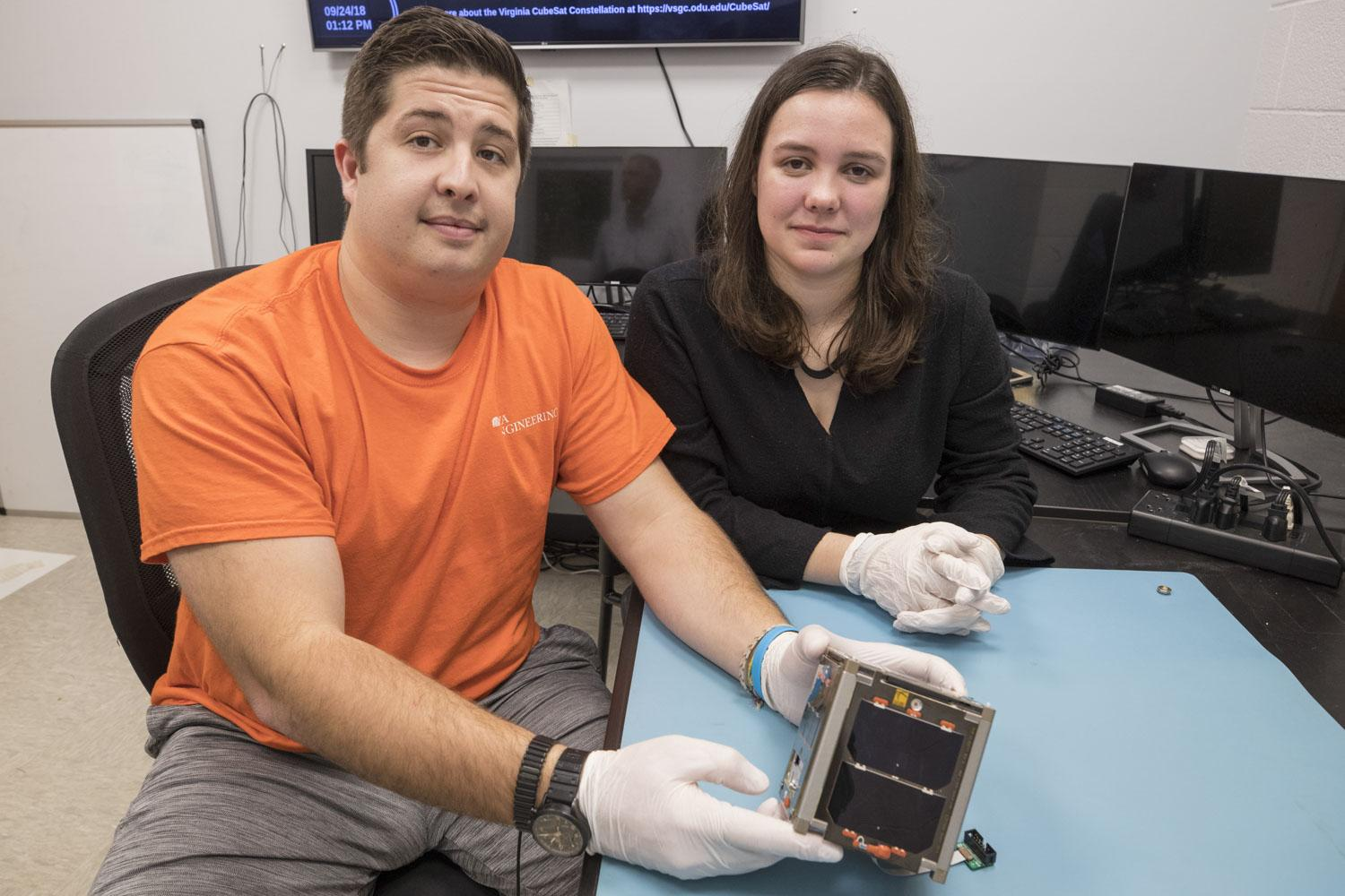 "Engineering students Trace LaCour, Erin Puckette, and their student colleagues have dedicated ""many, many hours"" to preparing their CubeSat for space."