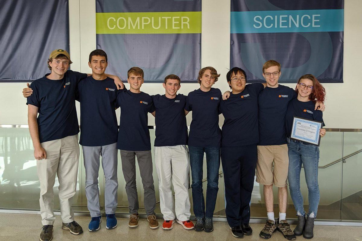 The UVA Cyber Defense Team – from left, William Tonks, Michael Benos, Paul Vann, Jake Smith, Calvin Krist, Daniel Chen, Jack McDowell and Maggie Gates – moved on to the national finals.