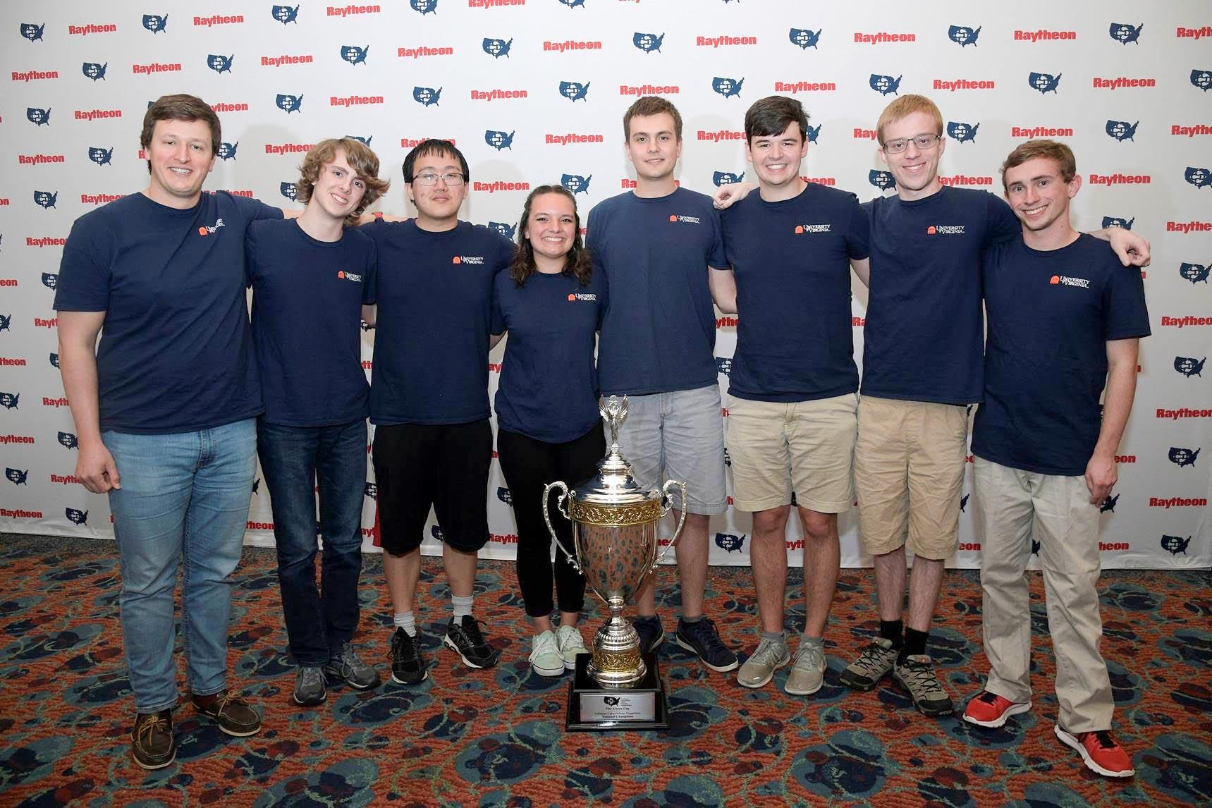 UVA's Cyber Defense Team, consisting of, from left, students Jack Verrier, Calvin Krist, Daniel Chen, Mariah Kenny, Roman Bohuk, Conner Steenrod, Jake Smith and Jack McDowell, celebrates their win.