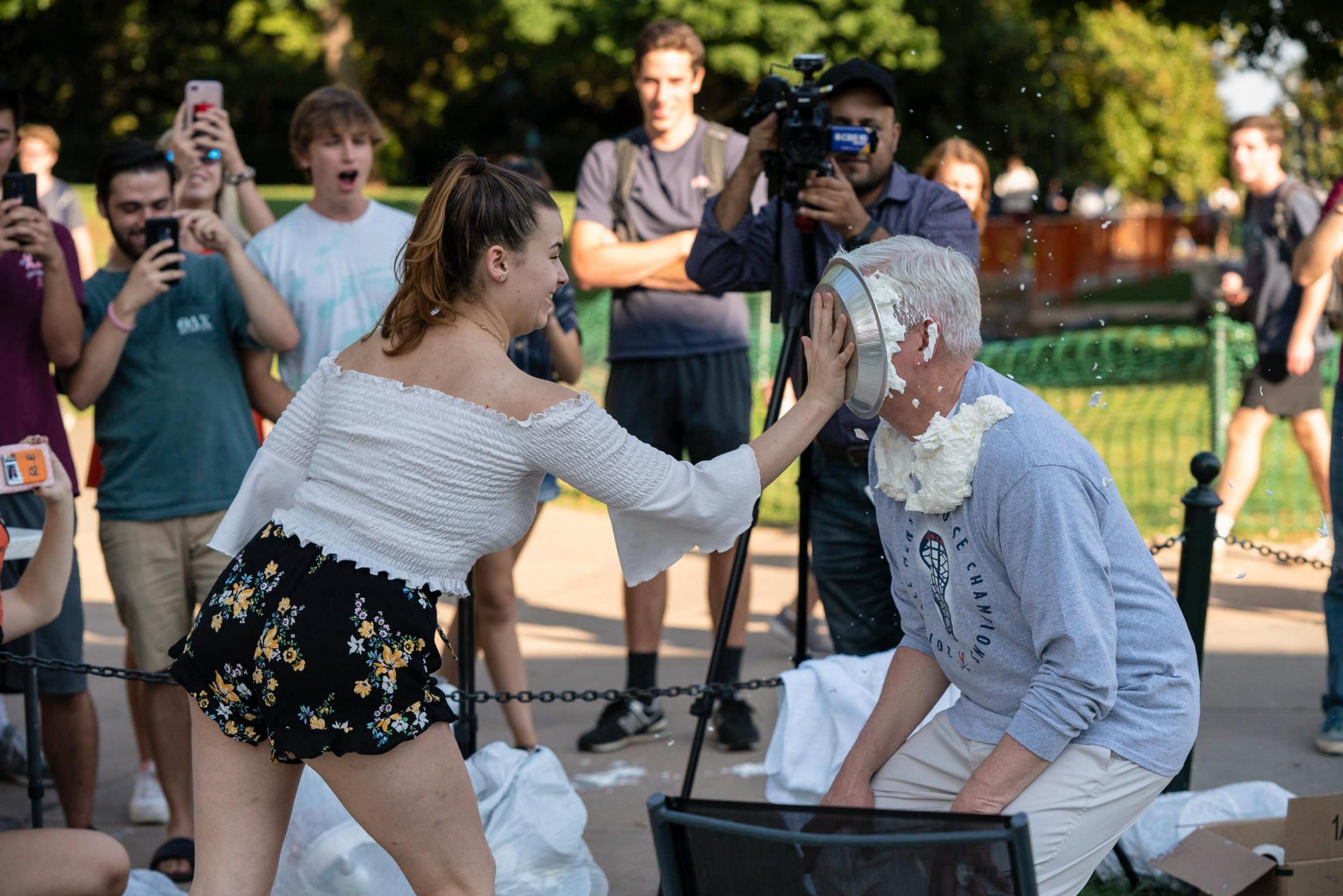 "Just over a month into her first year at UVA, Lilly Massey drew the honor of ""pie-ing"" Dean of Students Allen Groves for a fraternity's fundraiser. \"