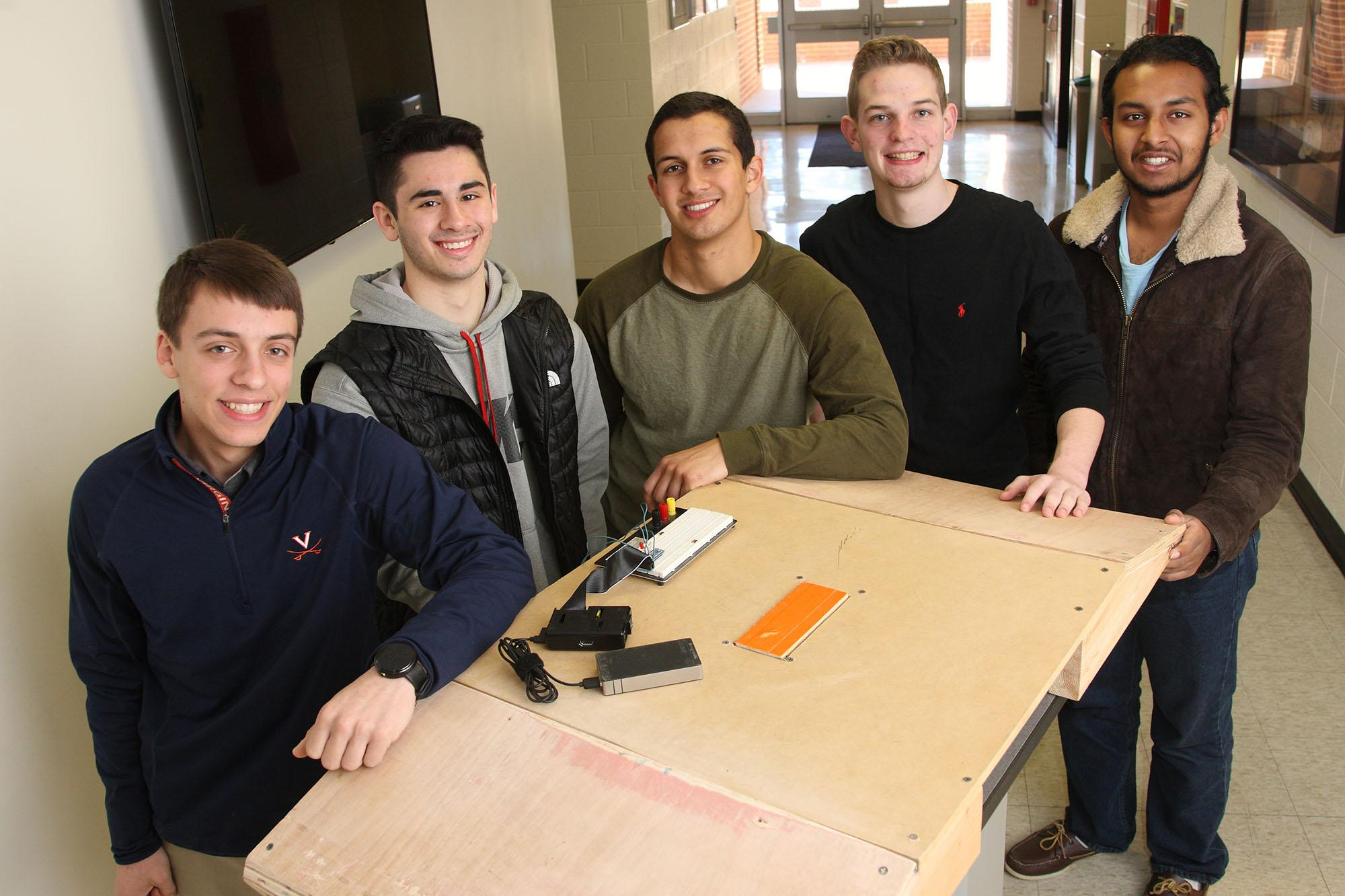 First-year engineering students, from left, Daniel Voce, Andrew Gerin, Nick Field, John Ruppert and Vamshi Garikapati brainstormed a floor-installed pressure plate which, when triggered by a wheelchair, could open heavy doors.