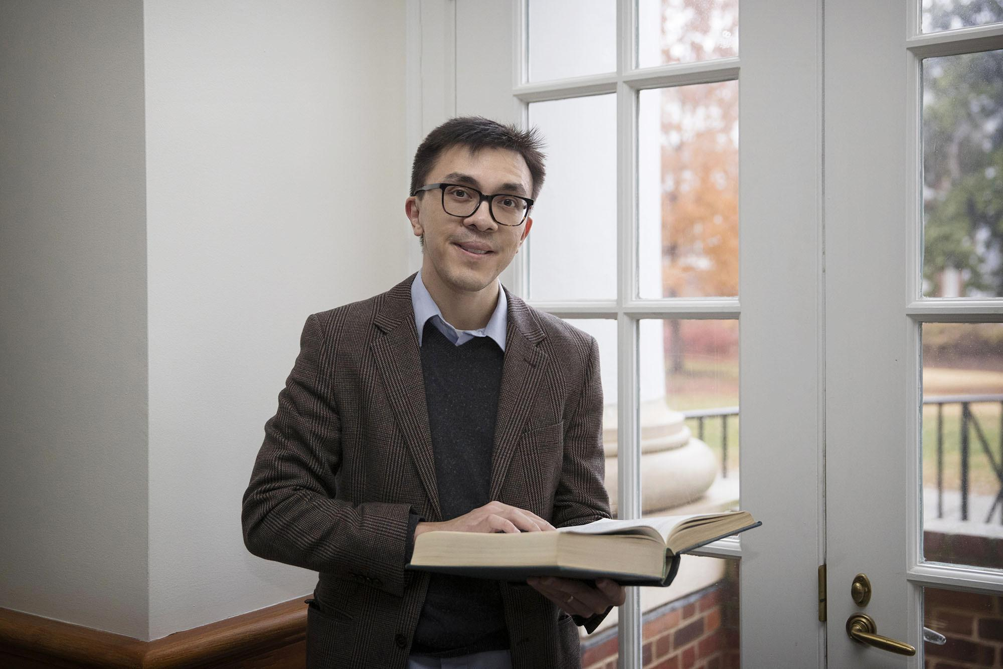 Economist Eric Chyn researches the impact of large-scale government programs like public housing assistance.