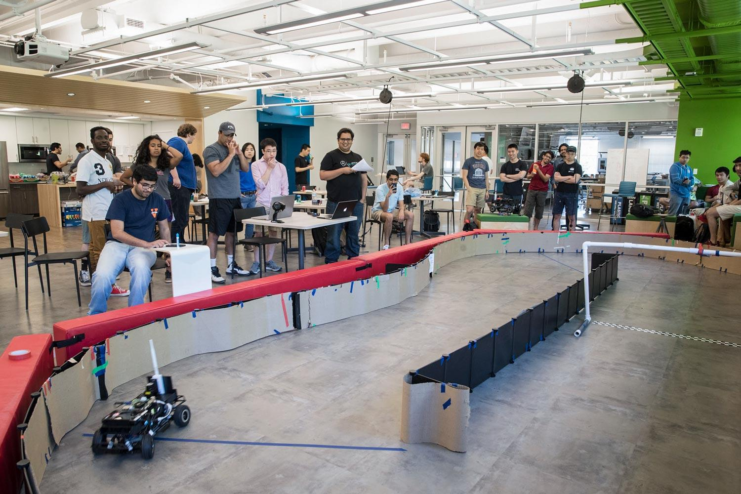 Computer science students raced their cars last week as their final exam.