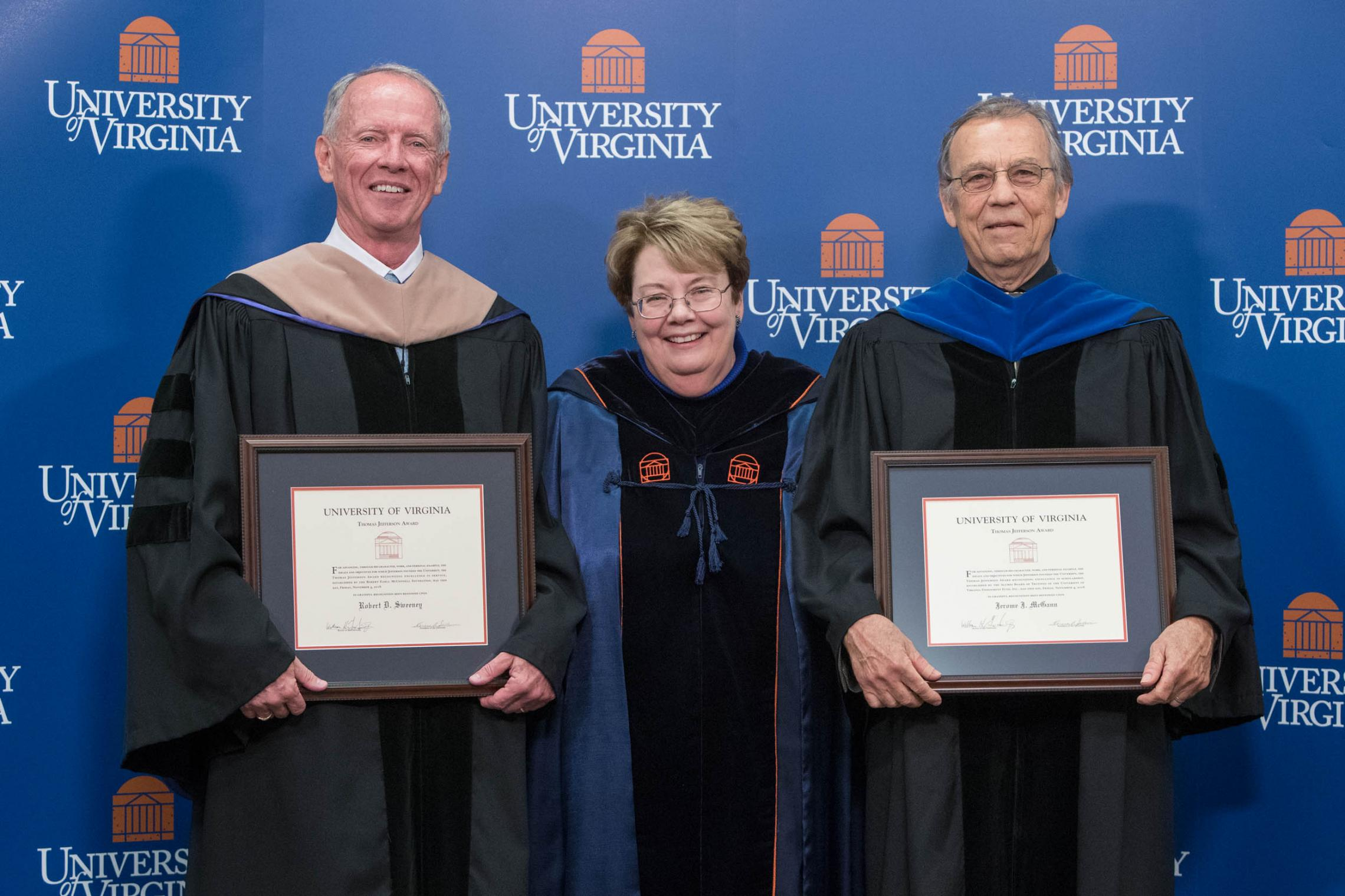 Thomas Jefferson Award winners Robert Sweeney, left, and Jerome McGann flank UVA President Teresa A. Sullivan at Friday's Fall Convocation. (Photos by Sanjay Suchak, University Communications)