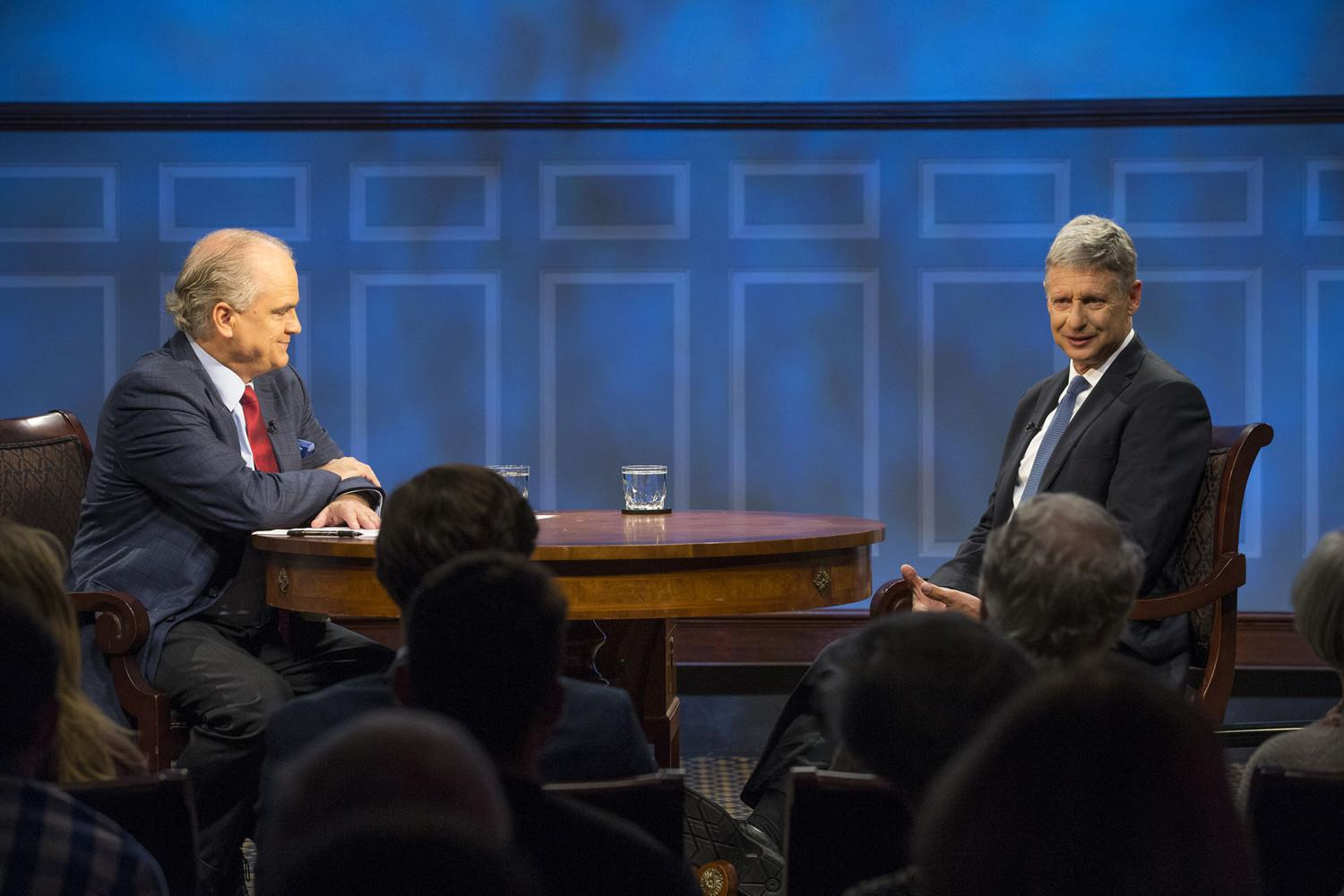 "Gary Johnson, right, appeared on the Miller Center's ""American Forum"" on Monday."