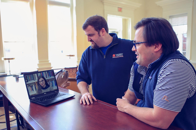 Darden students Stewart Gray and Mathew Reiss meet regularly with Jana Jurukovska to advise on her startup venture in Macedonia.