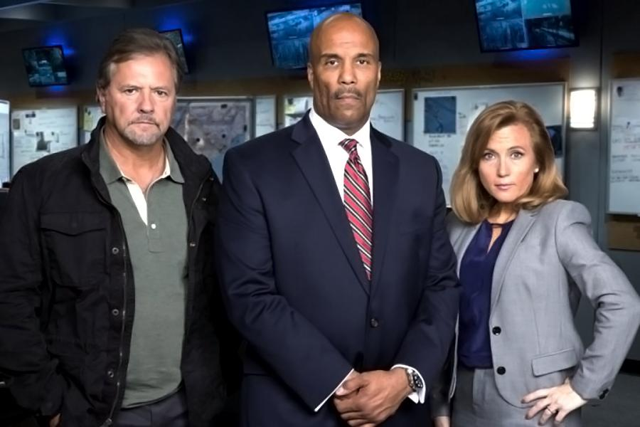 "Theresa Payton, right, is one of a team of cyber sleuths on the new CBS show. She is pictured with fellow ""hunters"" Lenny DePaul, left, a former U.S. Marshals commander, and Robert W. Clark, a former senior FBI official. (Photo: CBS)"