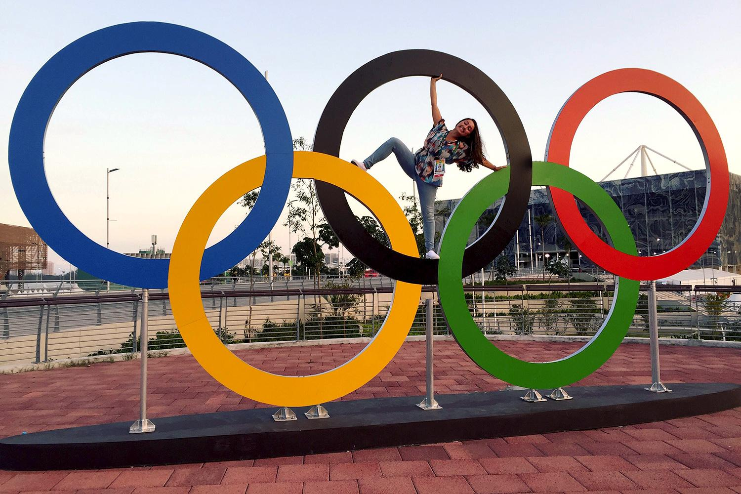 Third-year Alexandra D'Elia poses with the Olympic rings in Rio de Janeiro. (Contributed photos)