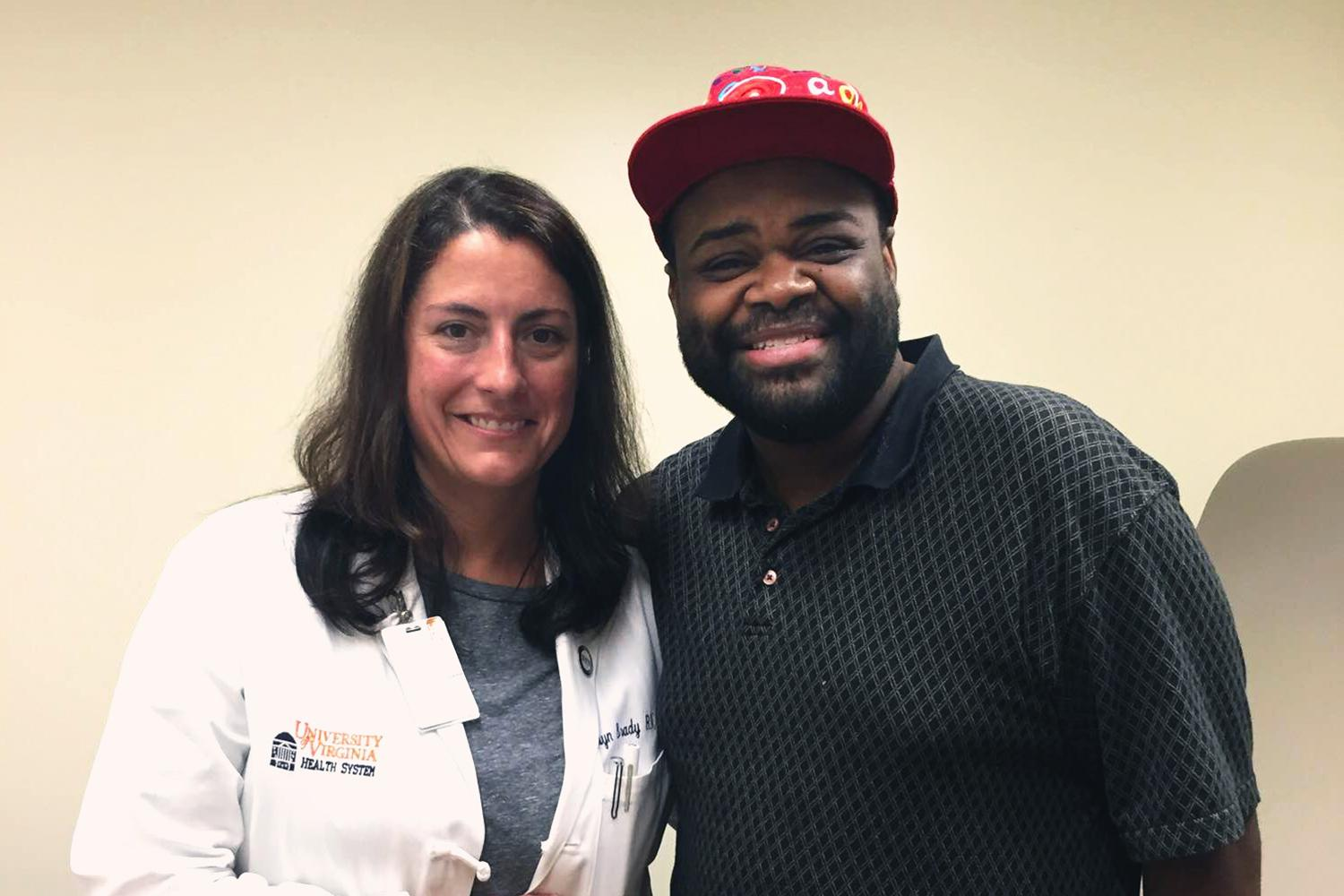 Nurse practitioner Carolyn Brady meets with patient Jason Dent, who was able to attend his college graduation ceremony a few weeks after being treated for heart failure at the UVA Medical Center.