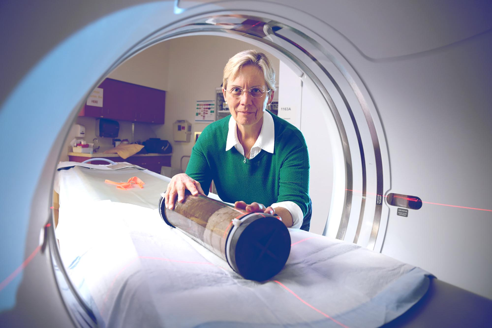 Environmental scientist Linda Blum uses CT scan facilities at the UVA Health System to examine salt marsh core samples.