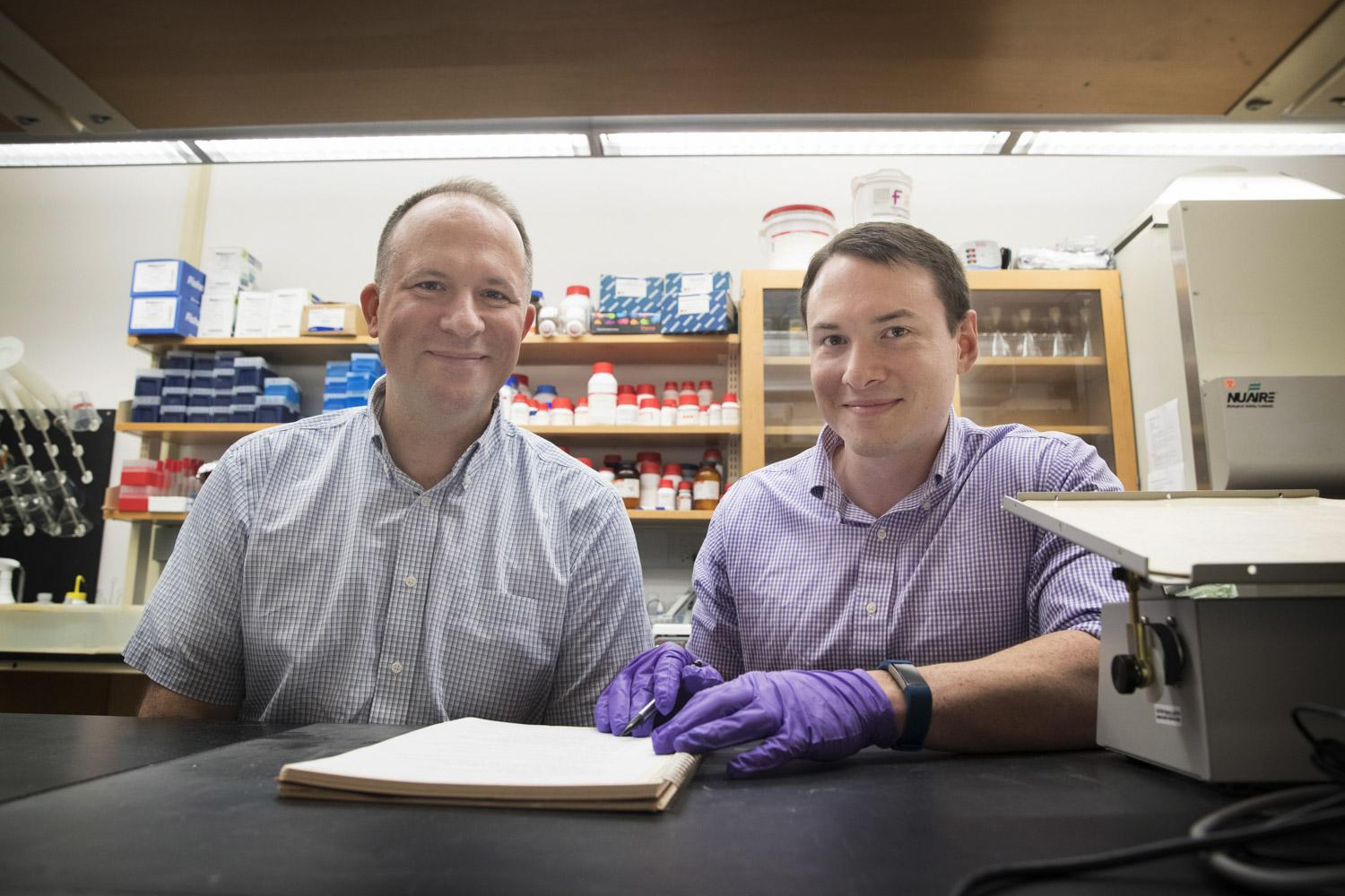 "Jason Papin, left, and Greg Medlock ""took a step back"" and figured out a new way to identify how different bacteria interact within the microbiome."
