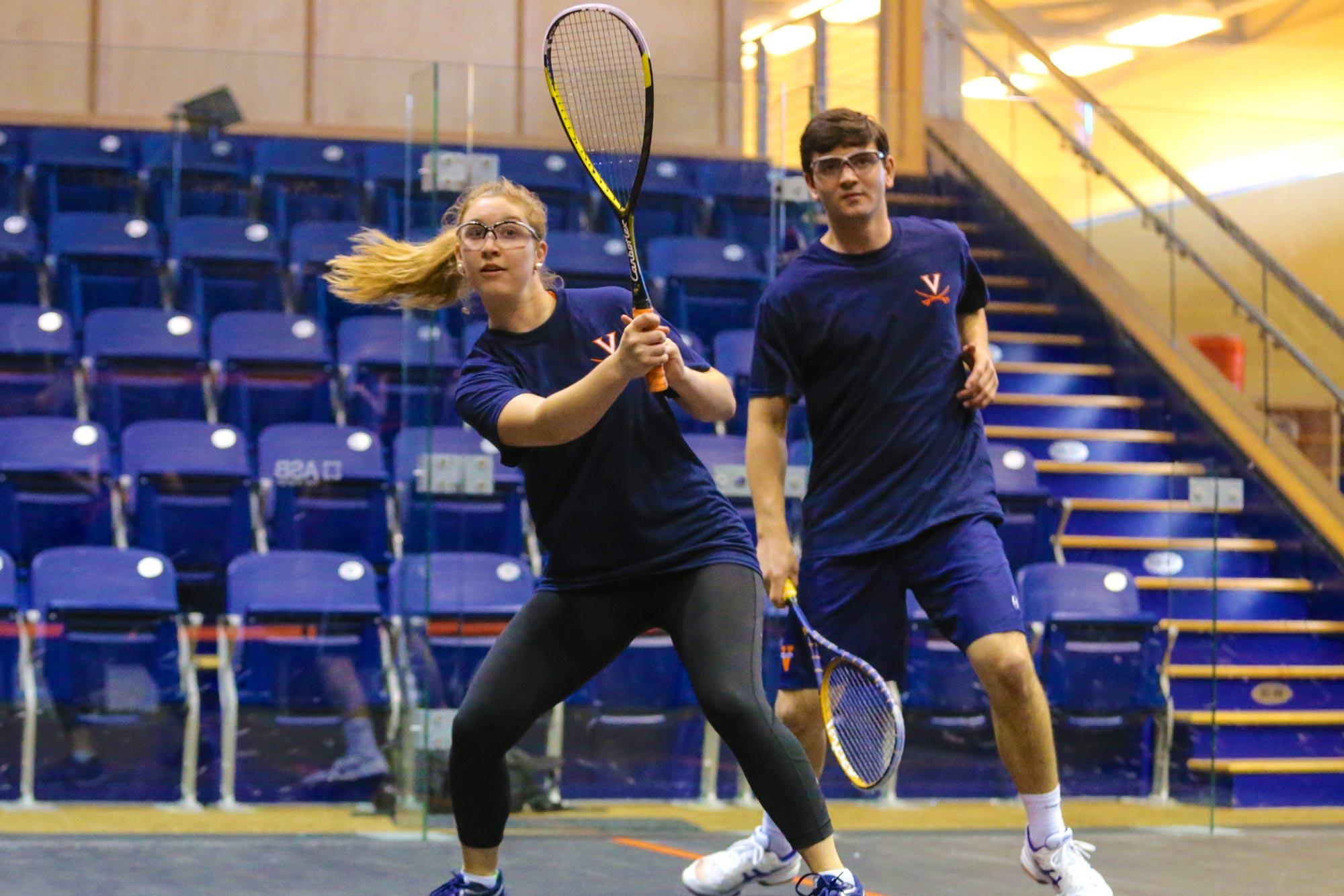 UVA squash players Julia Thompson and Harrison Kapp in action at the McArthur Squash Center. (Photos by Jim Daves, UVA Athletics)