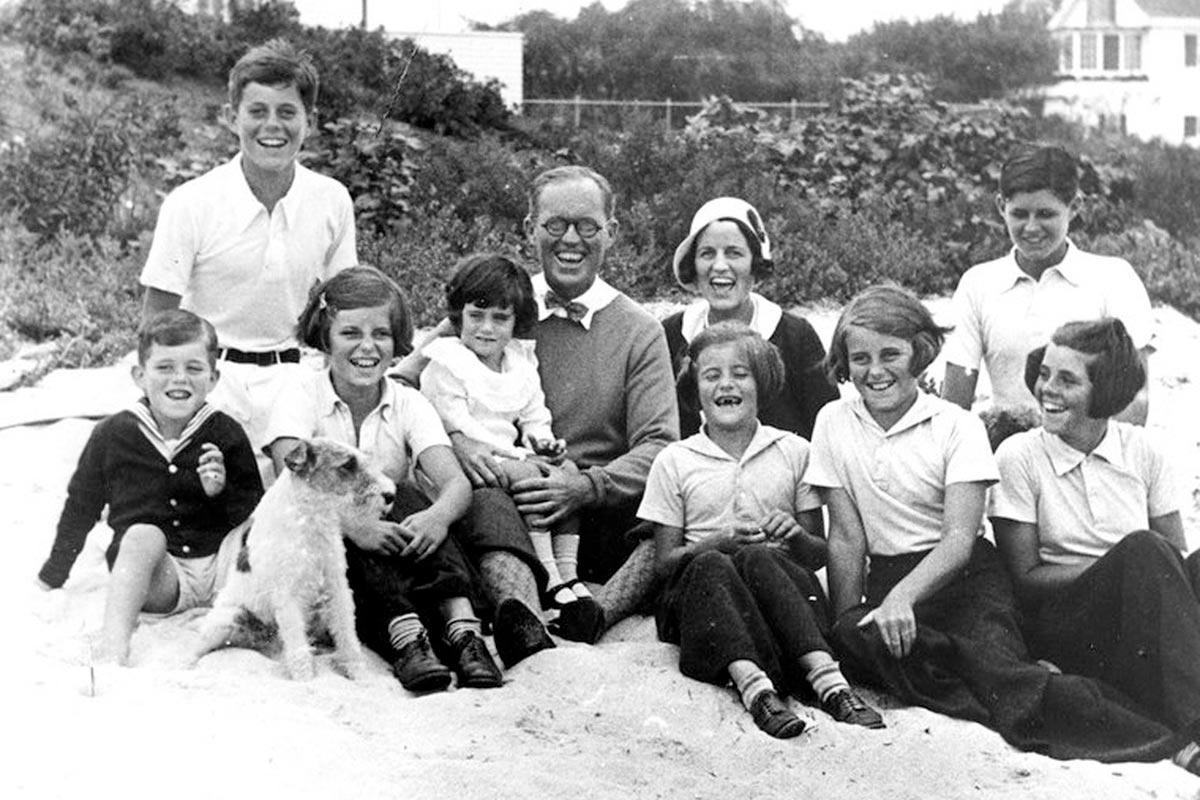 Joe and Rose Kennedy, center, with their eight children at Hyannis Port, Massachusetts. Ted Kennedy was born a year later.
