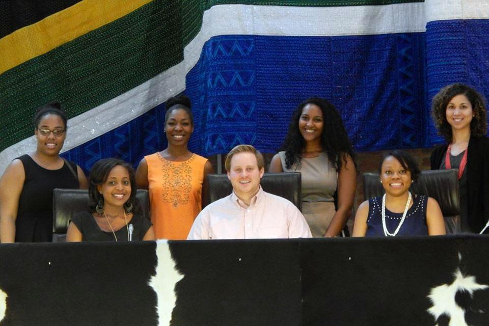 Left to right, front to back, UVA Law students Deitra Jones, Jeremy Lofthouse, Camille Grant, Jessica Douglas, Kirsten Jackson, Keisha James and Amber Strickland sit on the bench of the Constitutional Court.
