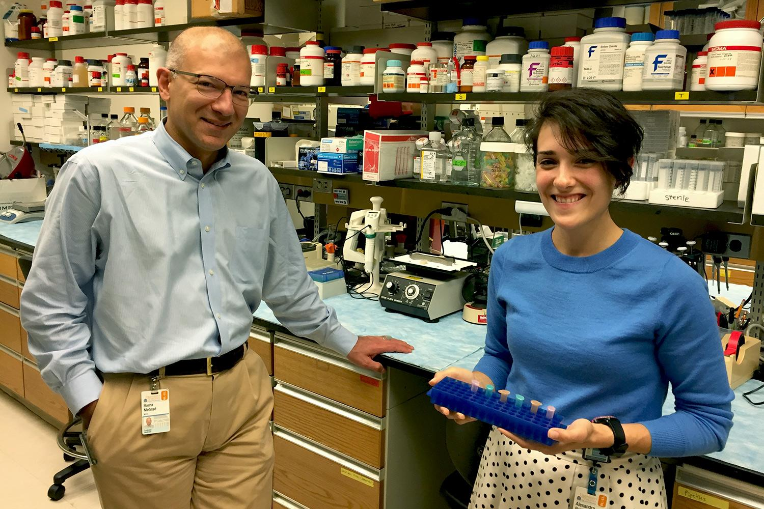 Research by doctoral student Alexandra Bettina, right, caused Dr. Borna Mehrad to rethink his hypothesis on the role of an important molecule in inhibiting pneumonia infections.