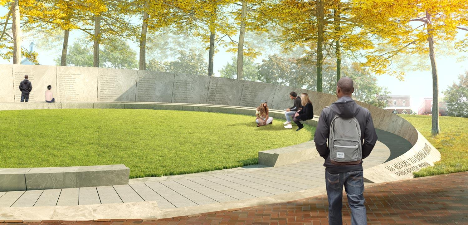 The memorial design features a circular stone wall, open at one section, which rises from the open green area northeast of the Rotunda.