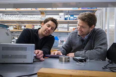 Michael Wheeler, left, and Ali Deniz Güler engineered a synthetic gene that, used in conjunction with a magnetic field, allows them to control neural circuits.