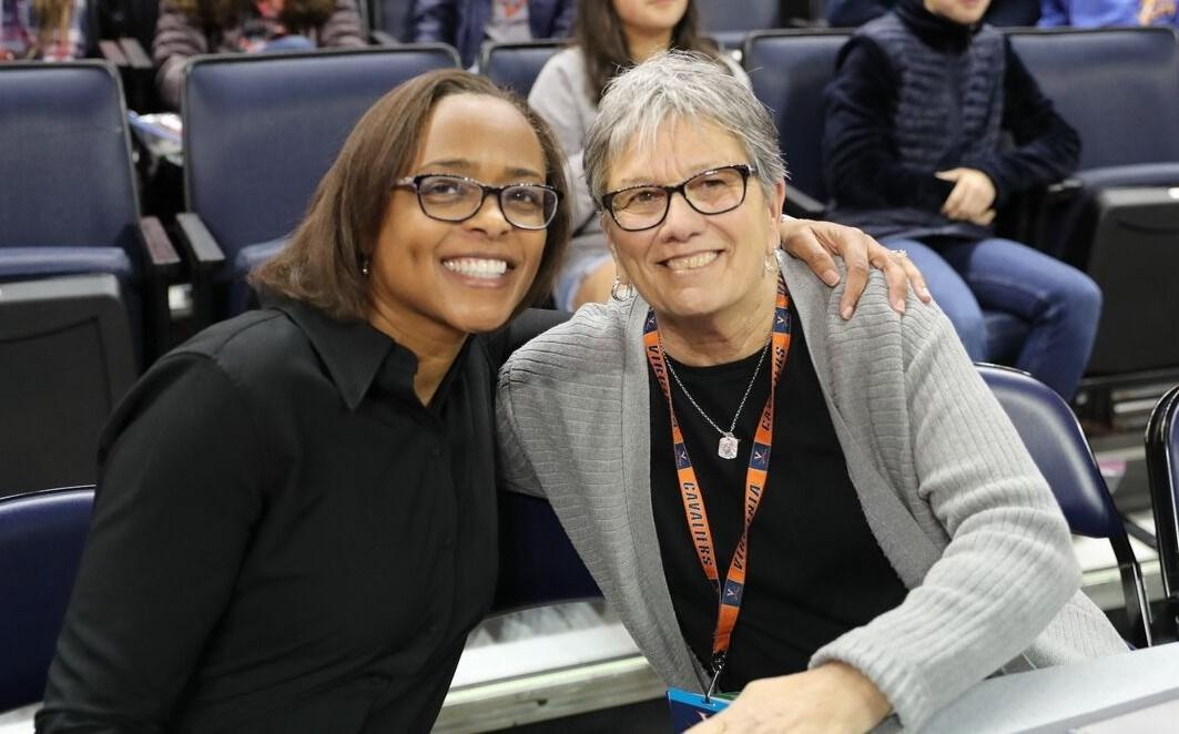 Jane Miller, right, with Director of Athletics Carla Williams, has spent 35 years in UVA's Department of Athletics as a coach and administrator.