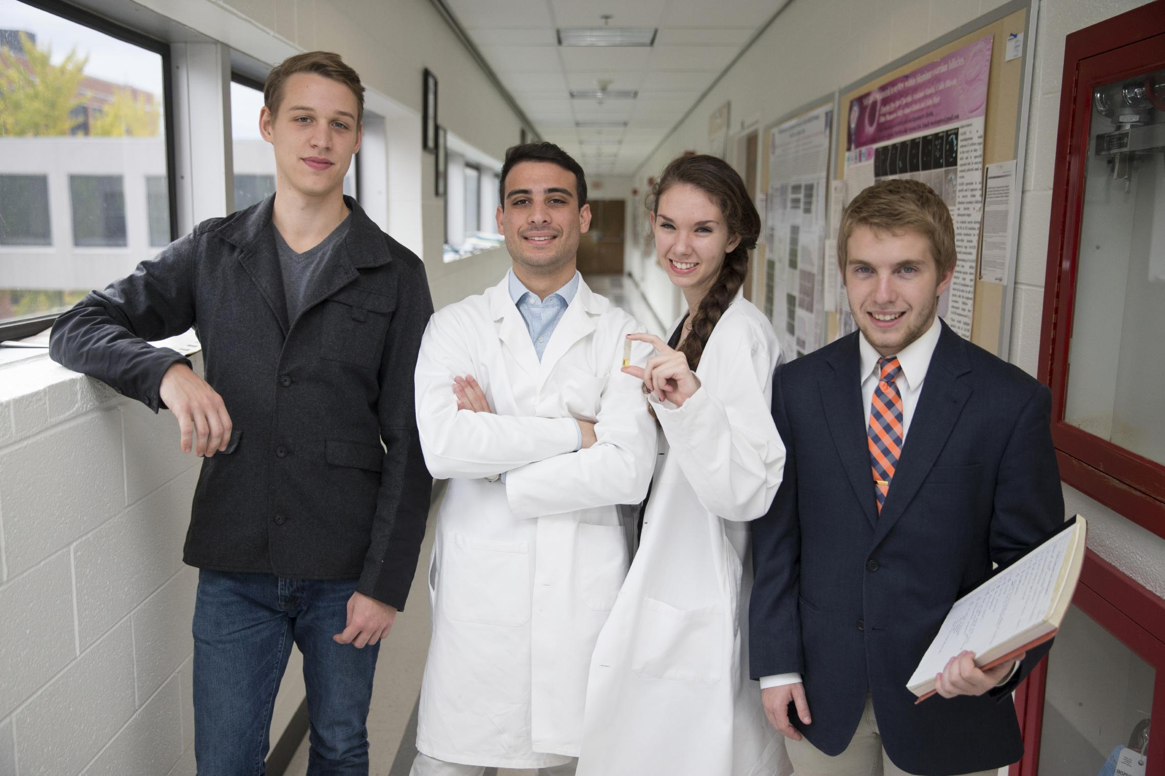 From left to right, Contraline team members Nicolas Hogan, Kevin Eisenfrats, Catherine Henry and Adam Ewel stand in their research space in UVA's Jordan Hall.