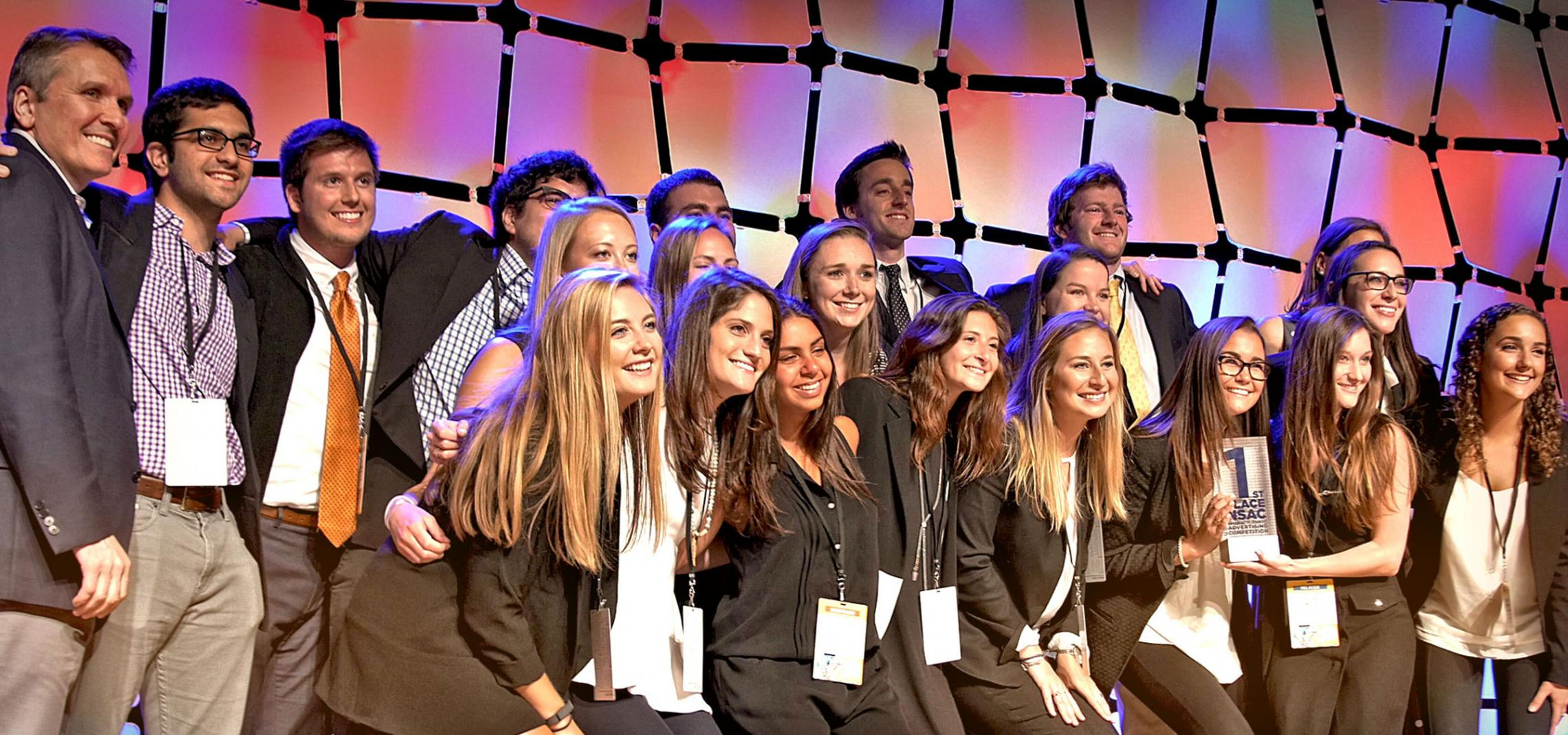 Professor Carrie Heilman, right, with her students after the class won the American Advertising Federation's 2016 National Student Advertising Competition.