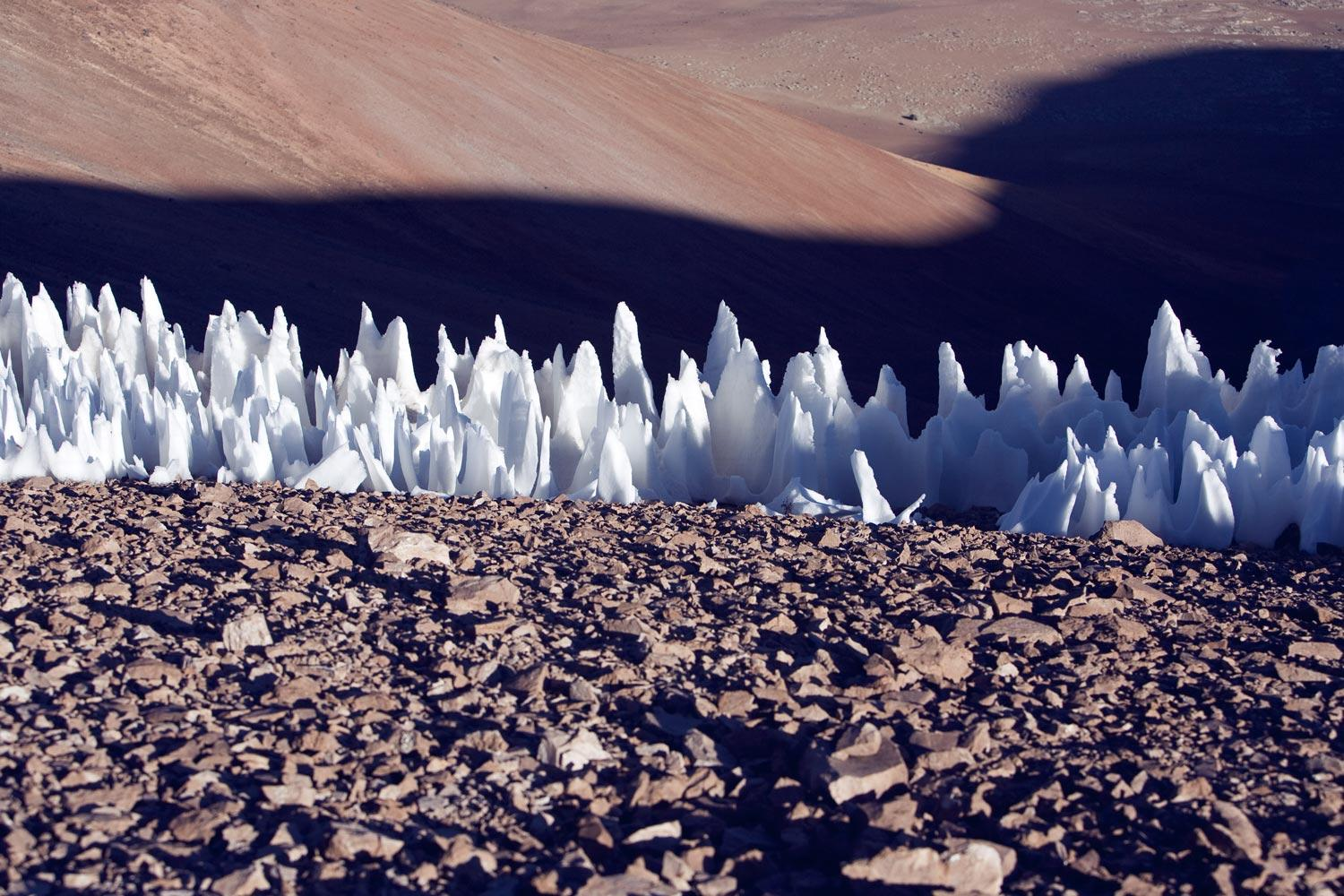 These natural ice spikes, called penitentes – which are several feet tall – are located on a dry plain of Chile. Could similar features on a moon of Jupiter create landing hazards for a NASA mission?