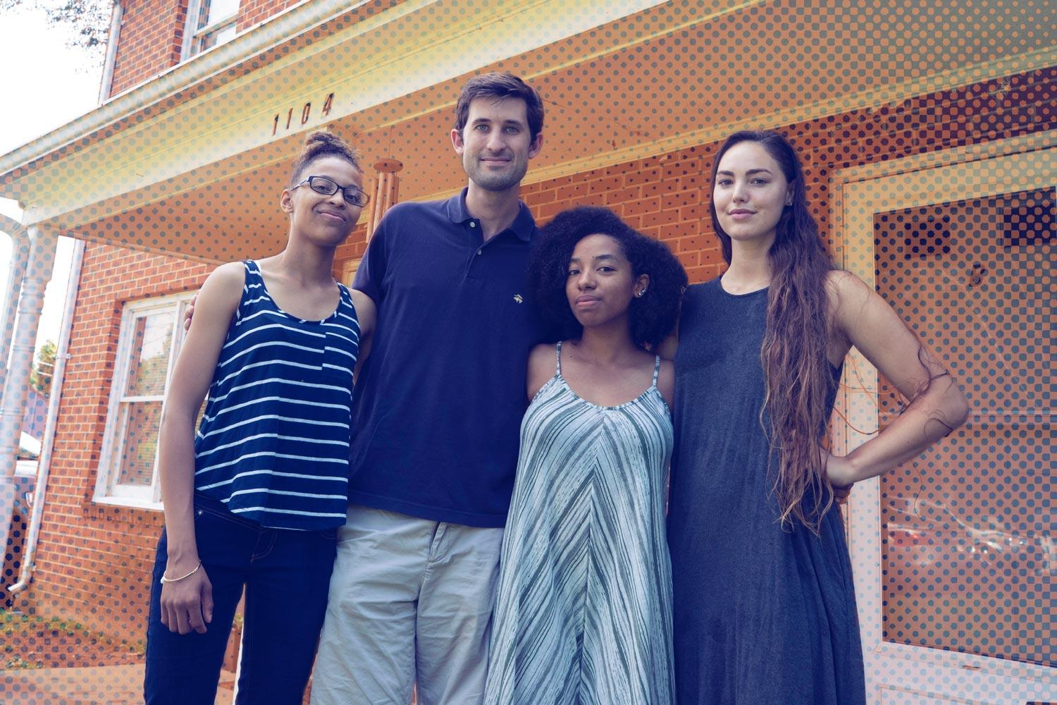 Third-year student Ameenah Elam, Perkins House Director Garrett Trent and third-year students Dominique DeBose and Isabella Hall in front of The Perkins House. (Photo by Dan Addison, University Communications)