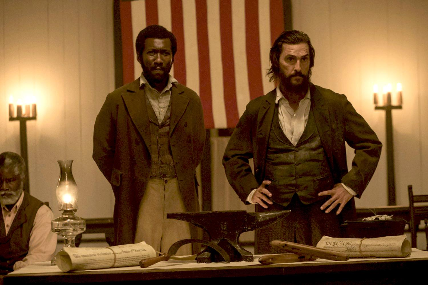 Matthew McConaughey, right, plays a white Mississippi farmer opposed to slavery who leads an uprising against the Confederacy, and Mahershala Ali plays Moses, a runaway slave who helps and joins him. (Photo by Murray Close/©2015 STX Productions LLC)