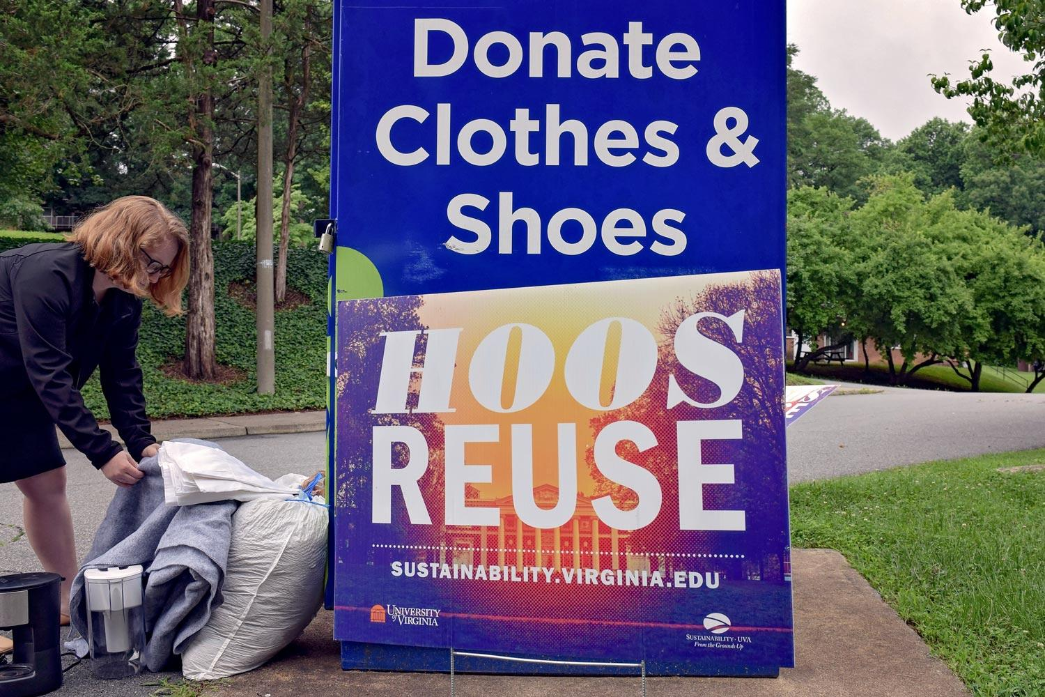 "Student Ruth Checknoff leaves donations in one of six Goodwill donation boxes deployed during this year's ""Hoos ReUse"" campaign."