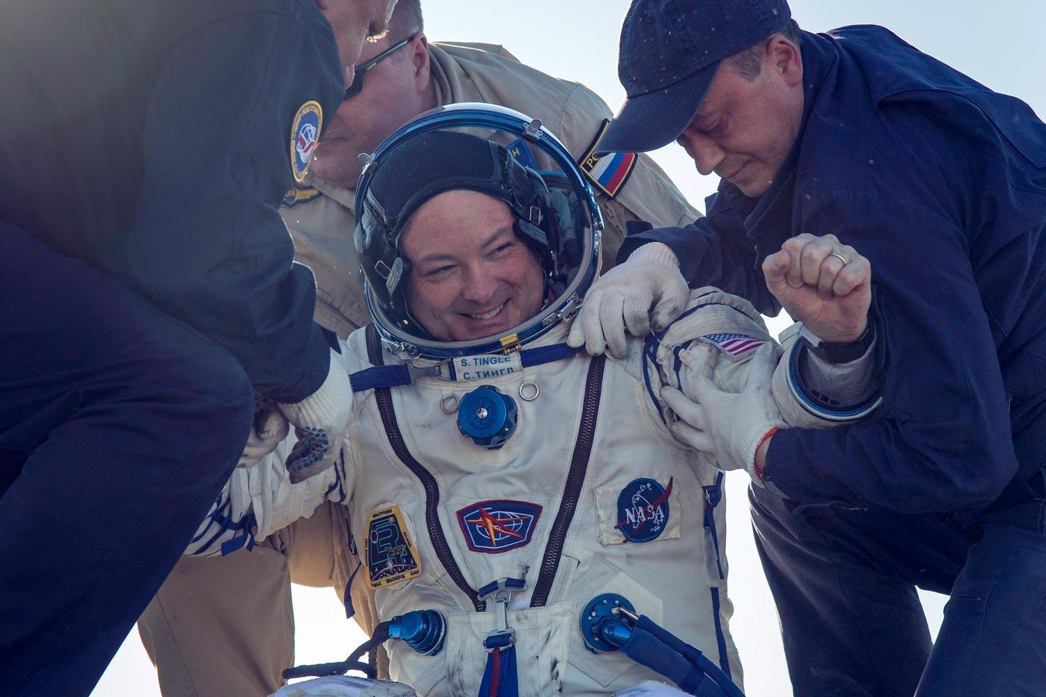 NASA astronaut Scott Tingle is helped out of the Soyuz MS-07 spacecraft just minutes after he and his fellow astronauts landed in a remote area of Kazakhstan on June 3.