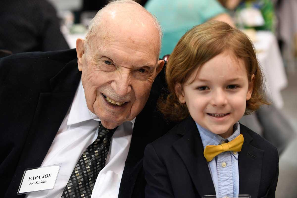 "Joseph C. ""Papa Joe"" Smiddy, pictured here with his grandson William, served as the first chancellor of UVA's College at Wise."