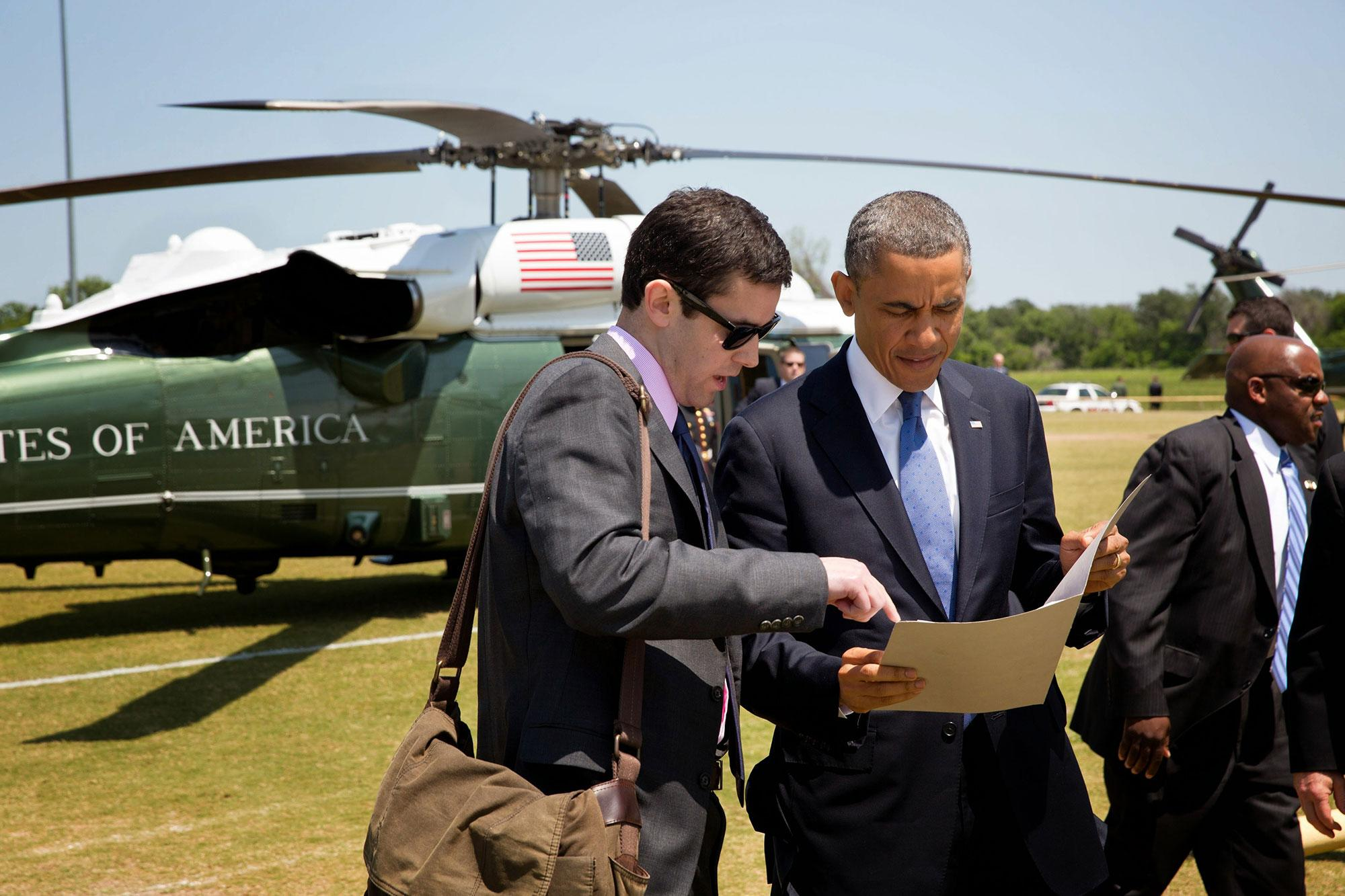 Kyle O'Connor discusses speech details with Obama as the president exits Marine One. (Photo by Pete Souza, Chief White House Photographer)