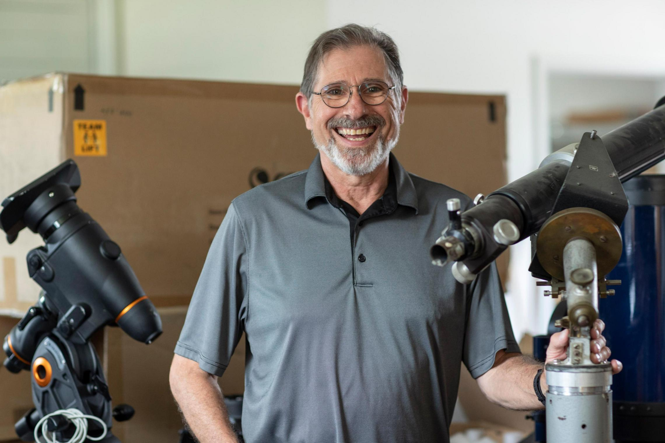 Steve Layman, an amateur astronomer who's made a career in music, works with the astronomy department to bring telescopes to schools and Scouts. (Photo by Sanjay Suchak, University Communications)