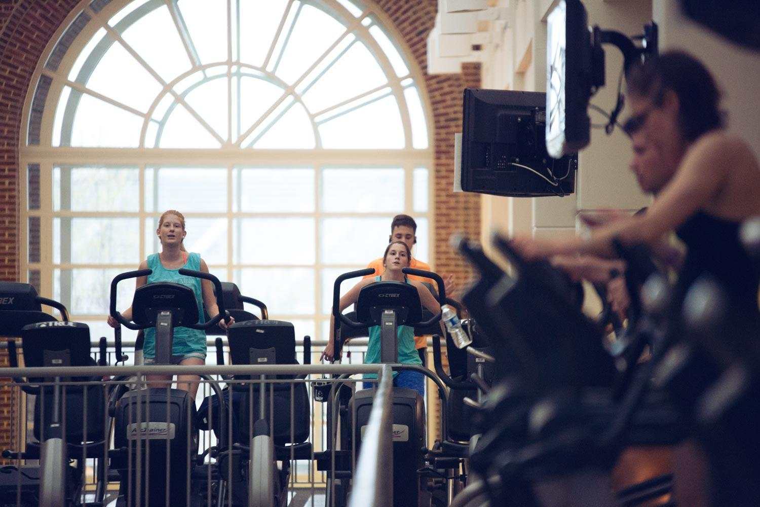Students work out at UVA's Aquatics & Fitness Center. A new study shows that exercise triggers a process called mitophagy, where the muscle disposes of damaged mitochondria, making the muscle and cells healthier.