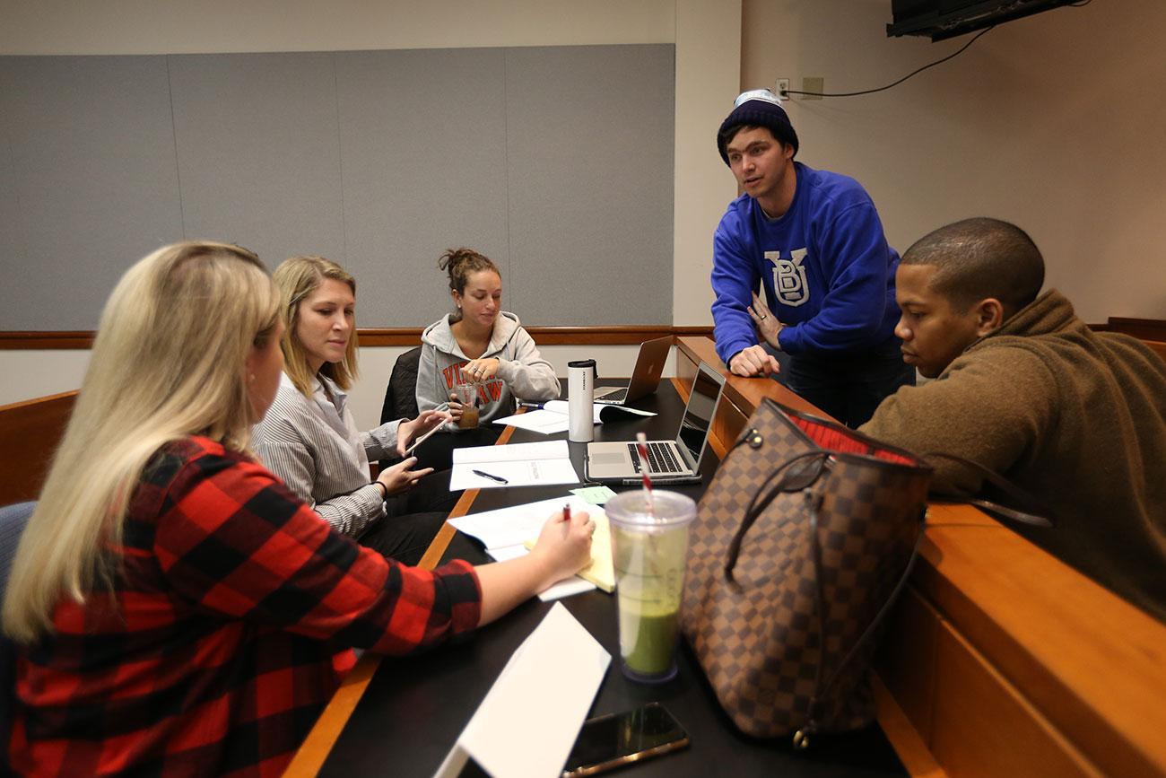 From left to right, students Carrington Giammittorio, Lauren Kramer, Elana King, Philip Hurst and P.J. Harris participate in a group negotiation exercise in which they represented a fictional country setting oil prices.