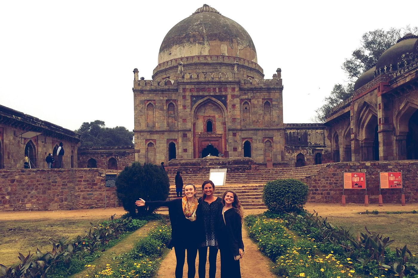 A trio of students visit the Old Fort in New Delhi.