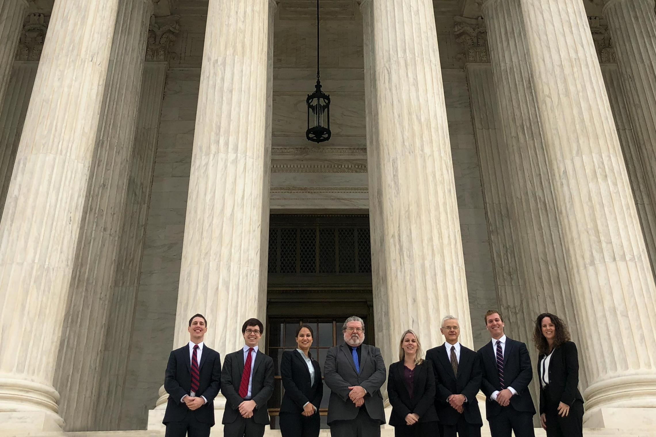Members of UVA Law's Supreme Court Litigation Clinic pose for a photo outside the U.S. Supreme Court.