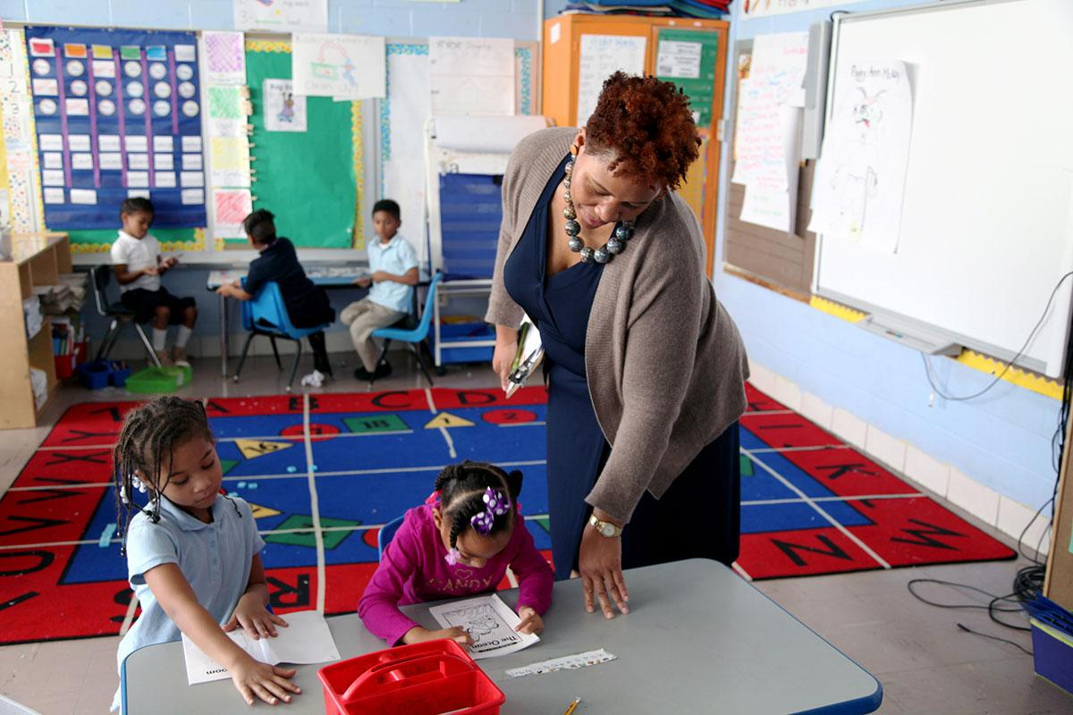 A principal observes students in a Washington, D.C. school. New research shows that though teacher turnover can often be a negative, students achieve more when low-performing teachers are replaced.