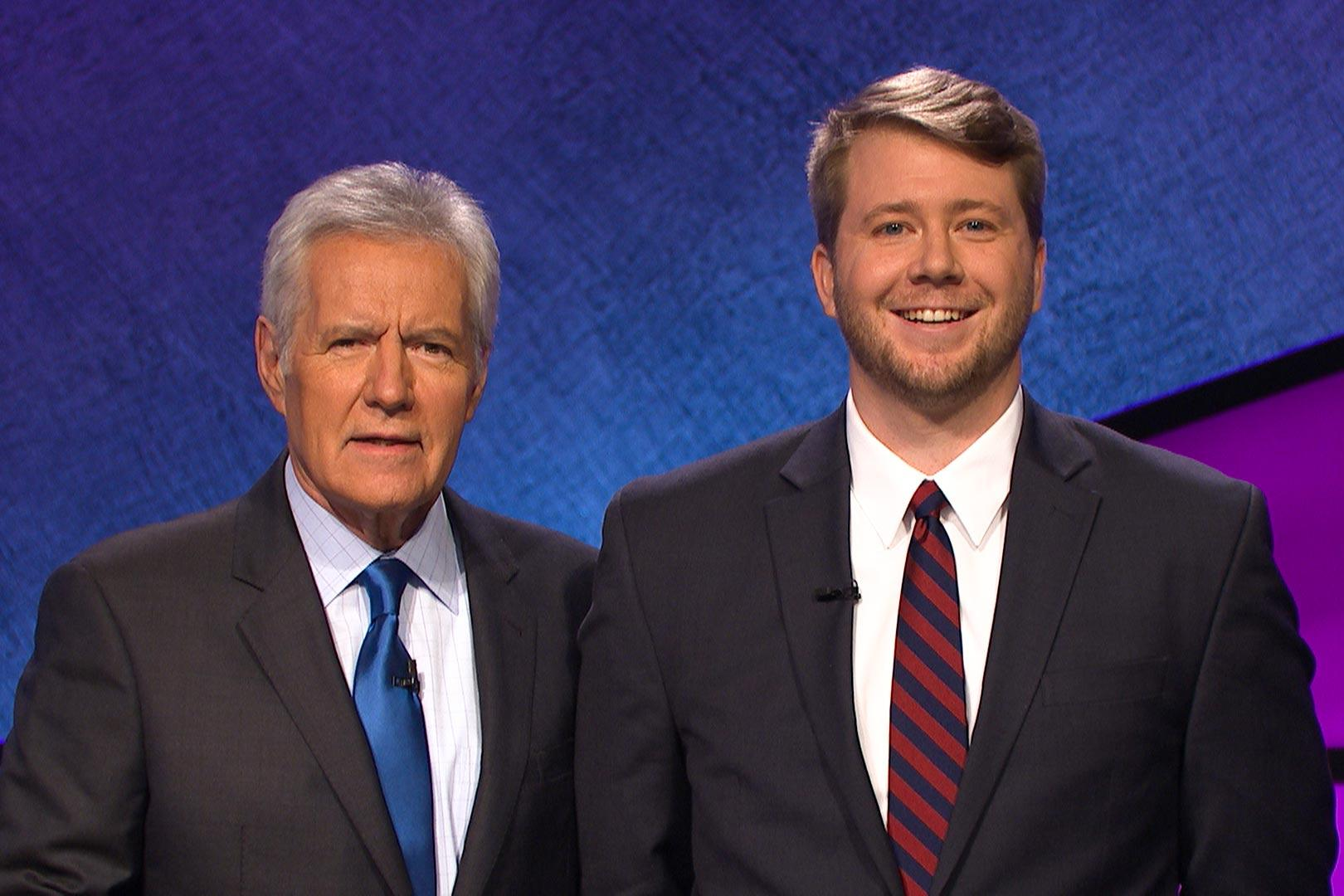 "Curry School doctoral candidate Terry Hanlon poses with Alex Trebek on the set of ""Jeopardy!"""